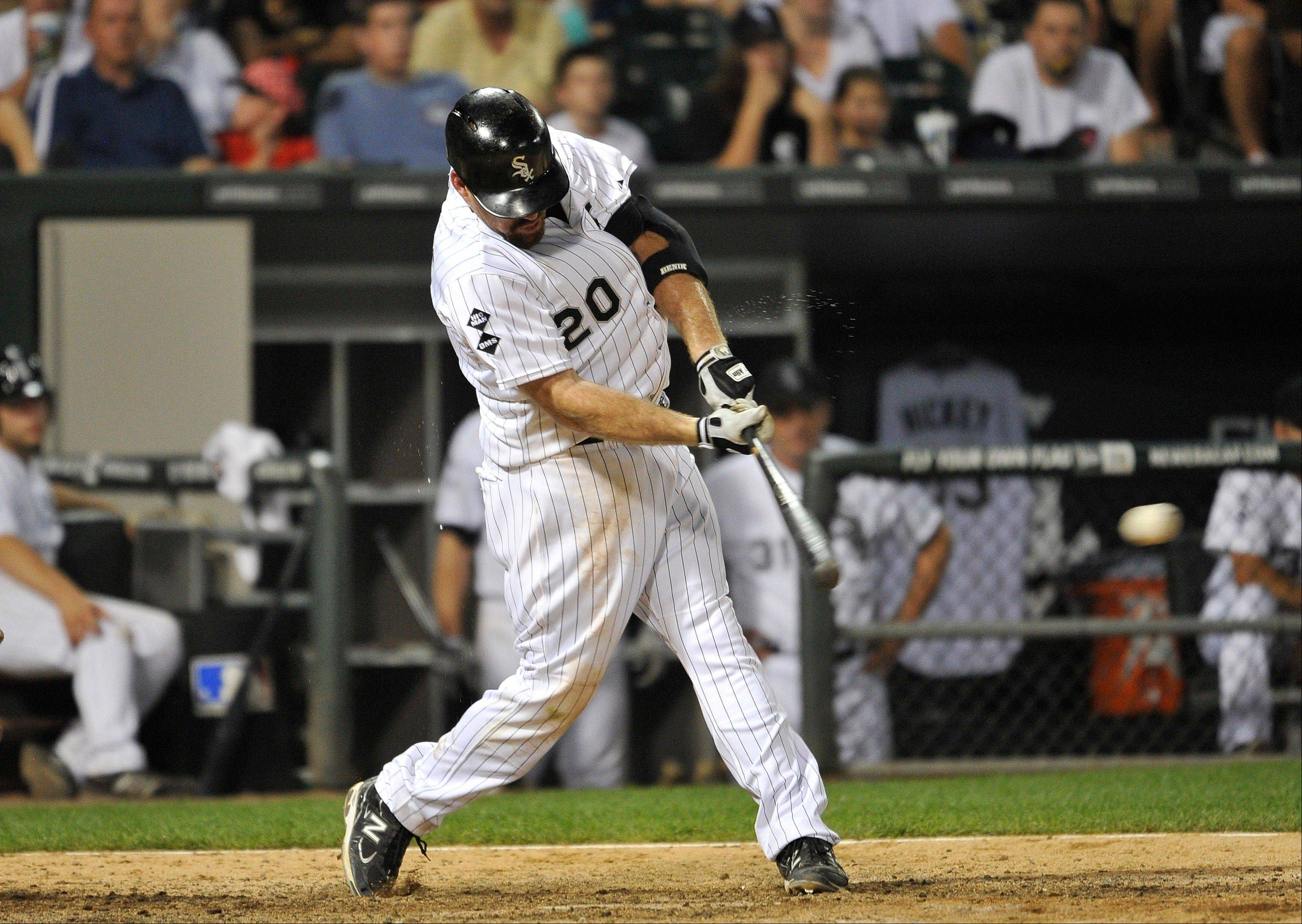 White Sox third baseman Kevin Youkilis connects on a game-winning RBI-single, scoring Alejandro De Aza, during the 10th inning of a baseball game against the Texas Rangers, Wednesday, July 4, 2012, in Chicago.