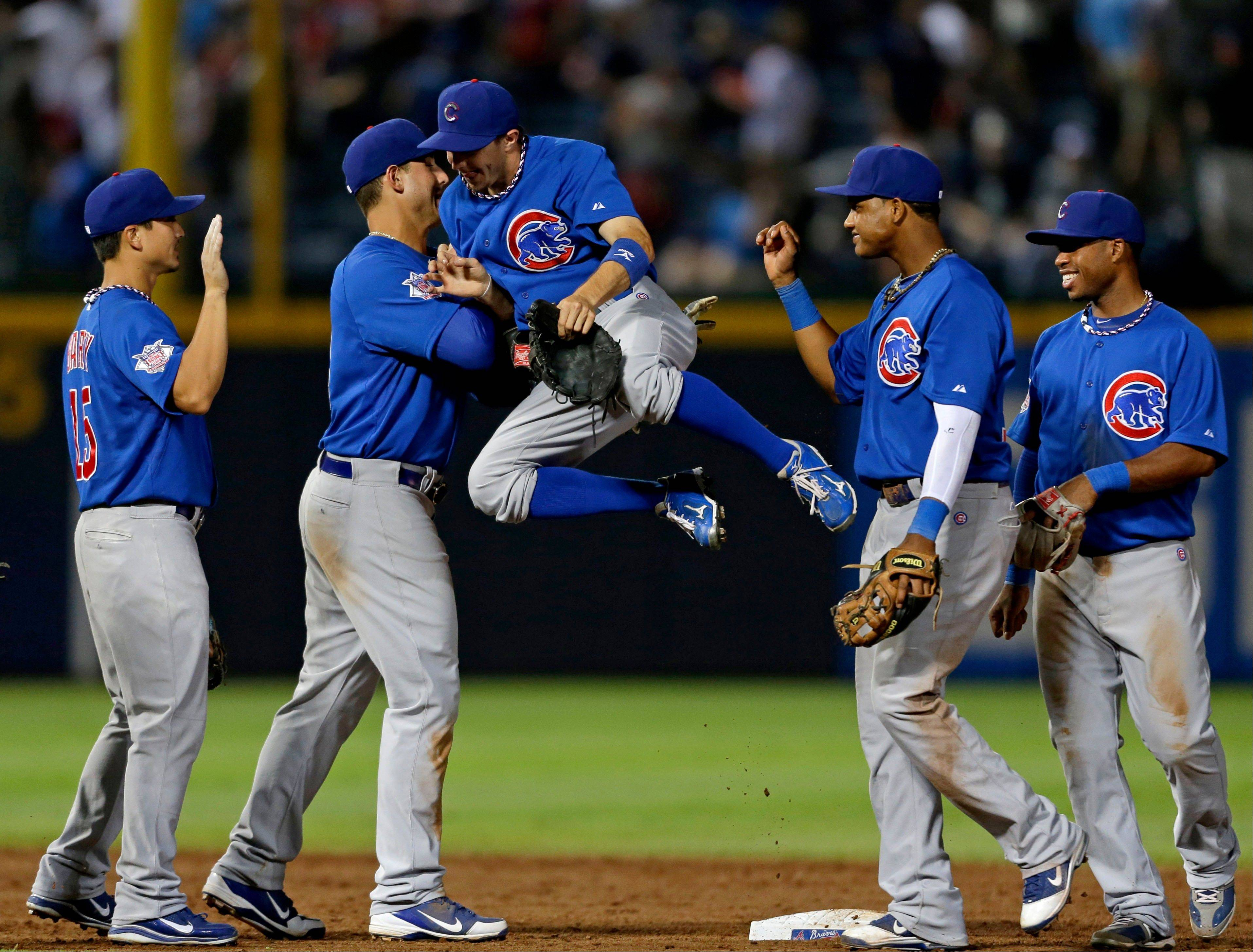 The Cubs� Tony Campana, center, jumps into teammate Anthony Rizzo, left, as the team celebrates their 5-1 win Wednesday over the Atlanta Braves.