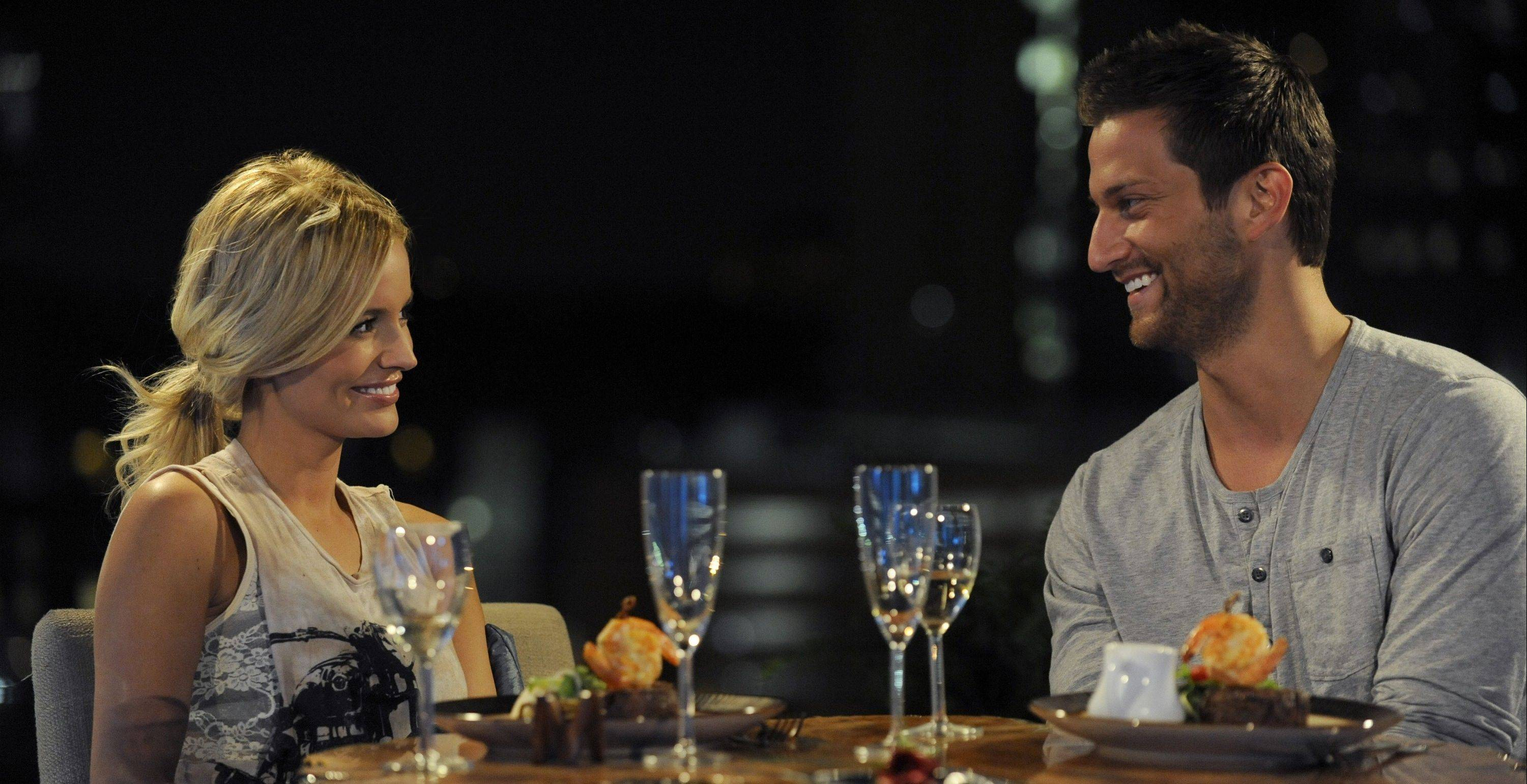"Chris Bukowski talks with Emily Maynard on an episode of ""The Bachelorette."" The Bartlett native will star on the upcoming season of ""Bachelor Pad."""