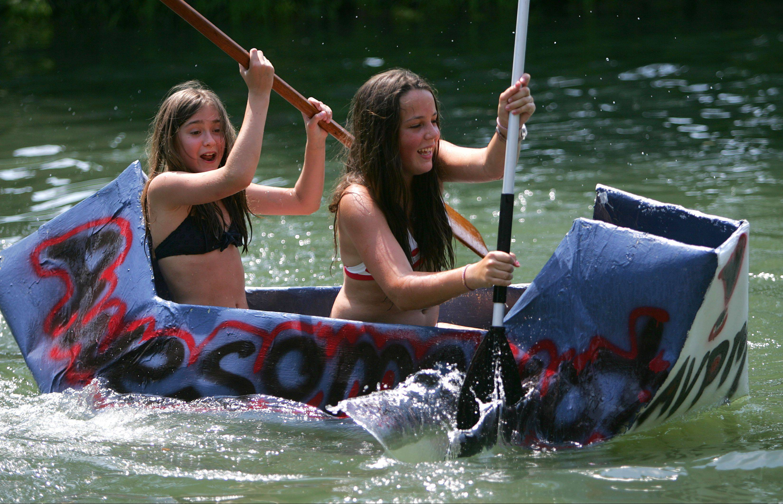 Twelve-year-old Sahsa Pinchuk, left, and 14-year-old Naomie Lapointe, both of Lincolnshire compete in a carboad boat regatta as Lincolnshire held its Red White and Boom 2012 event Wedensday at Spring Lake Park.