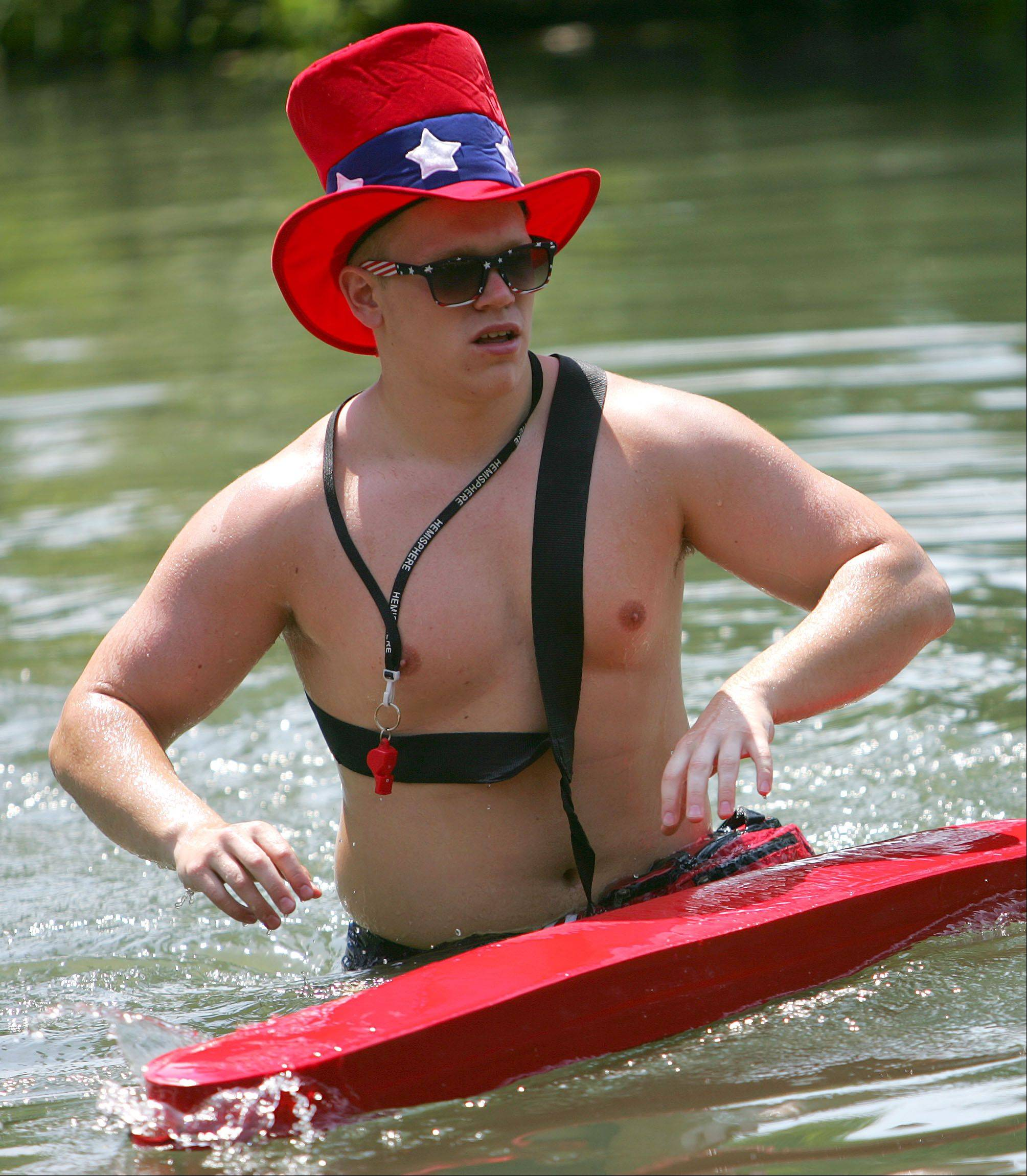 Lifeguard Robert Biedron dons a festive hat at Lincolnshire's Red White and Boom 2012 event Wednesday at Spring Lake Park.