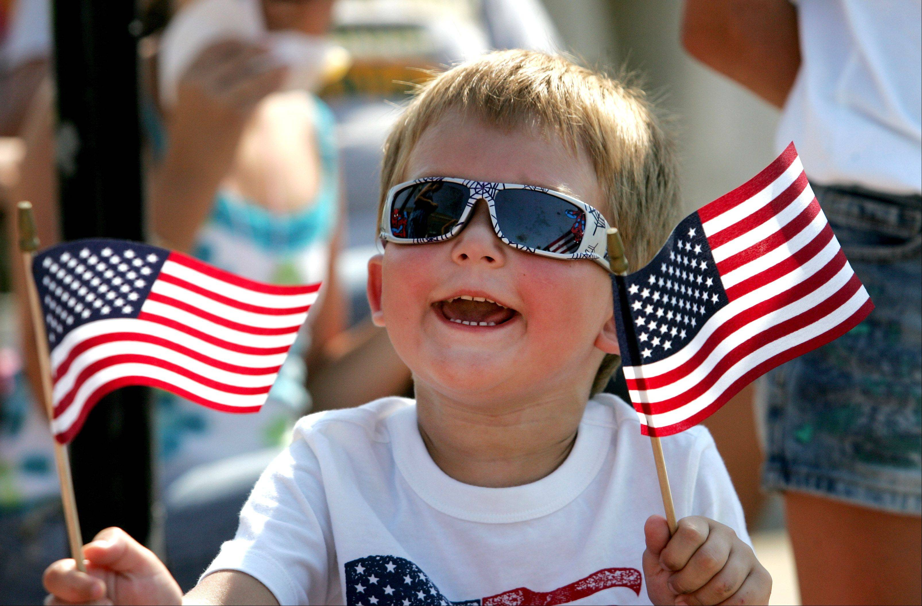 Ethan Greiff, 4, of Aurora, cheers the start of the 4th of July parade in Aurora on Wednesday.