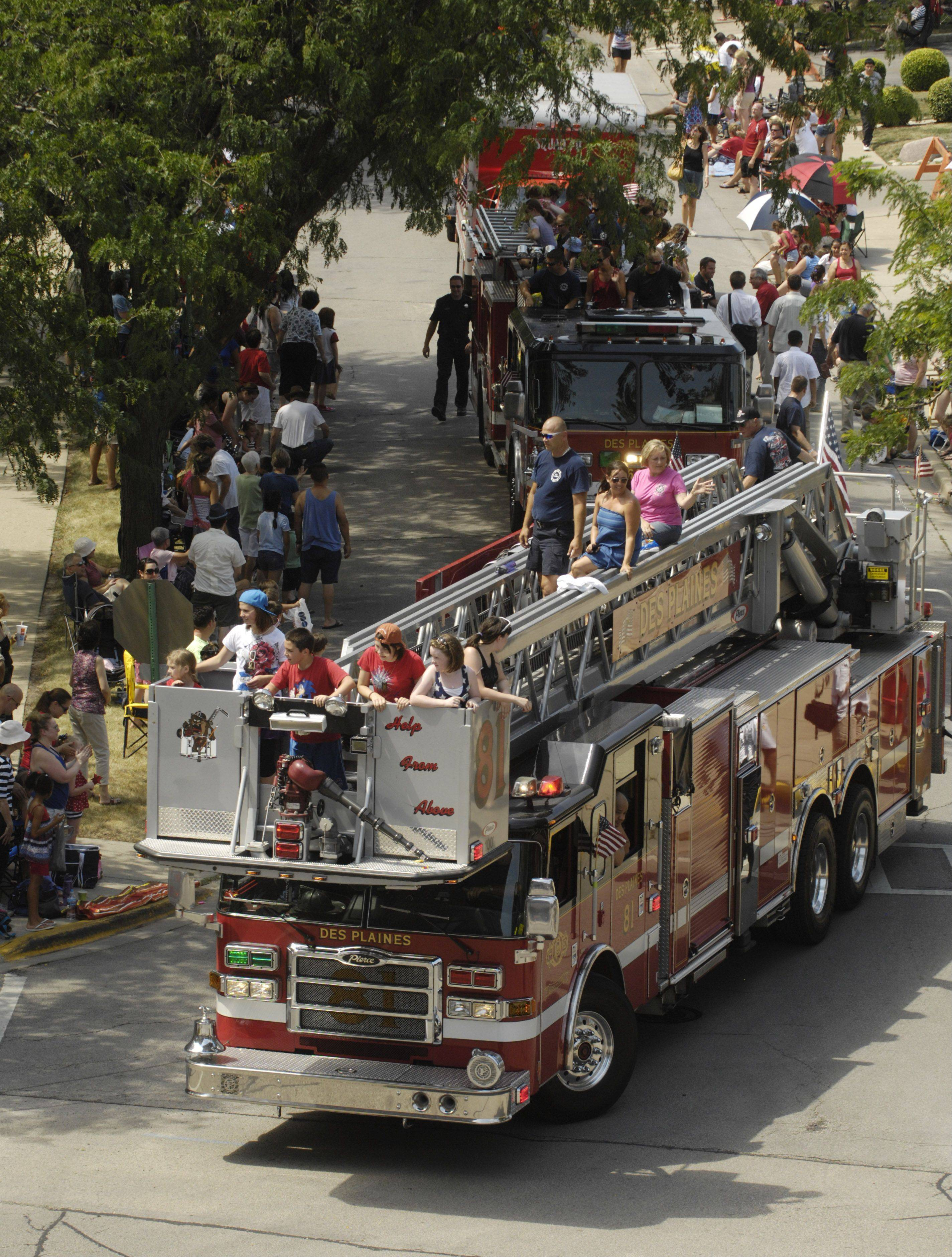 Fire engines pass during the Des Plaines Fourth of July parade Wednesday.