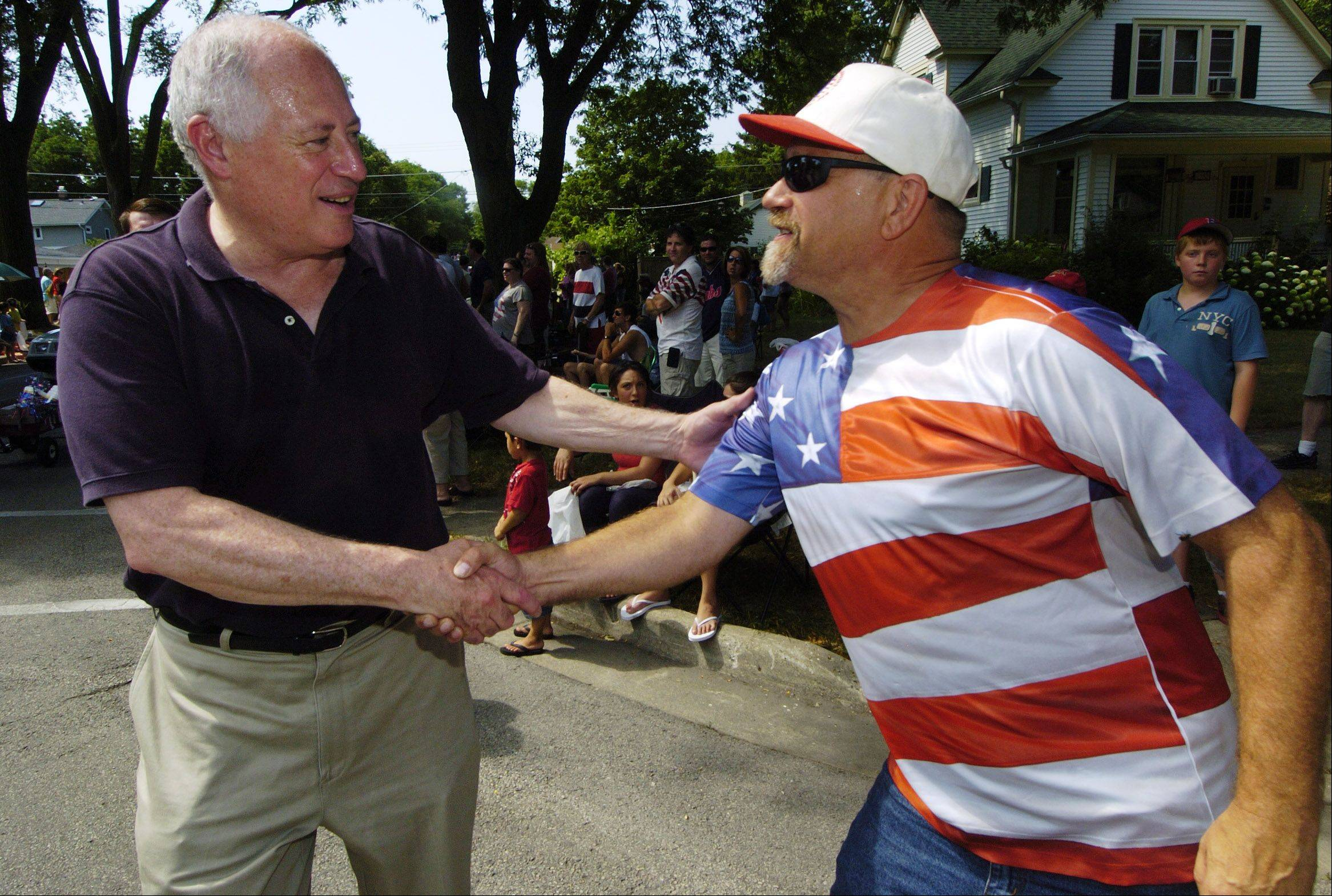 Governor Pat Quinn greets Joel Long of Des Plaines during the Des Plaines Fourth of July parade Wednesday.