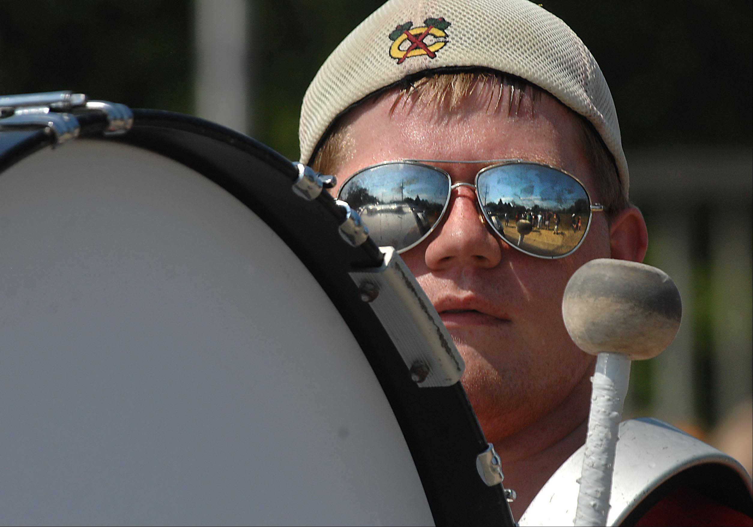 Base drummer Alex Miller can hardly see the crowd around his drum Wednesday at the South Elgin Fourth of July parade. He plays with the South Elgin High School marching band.