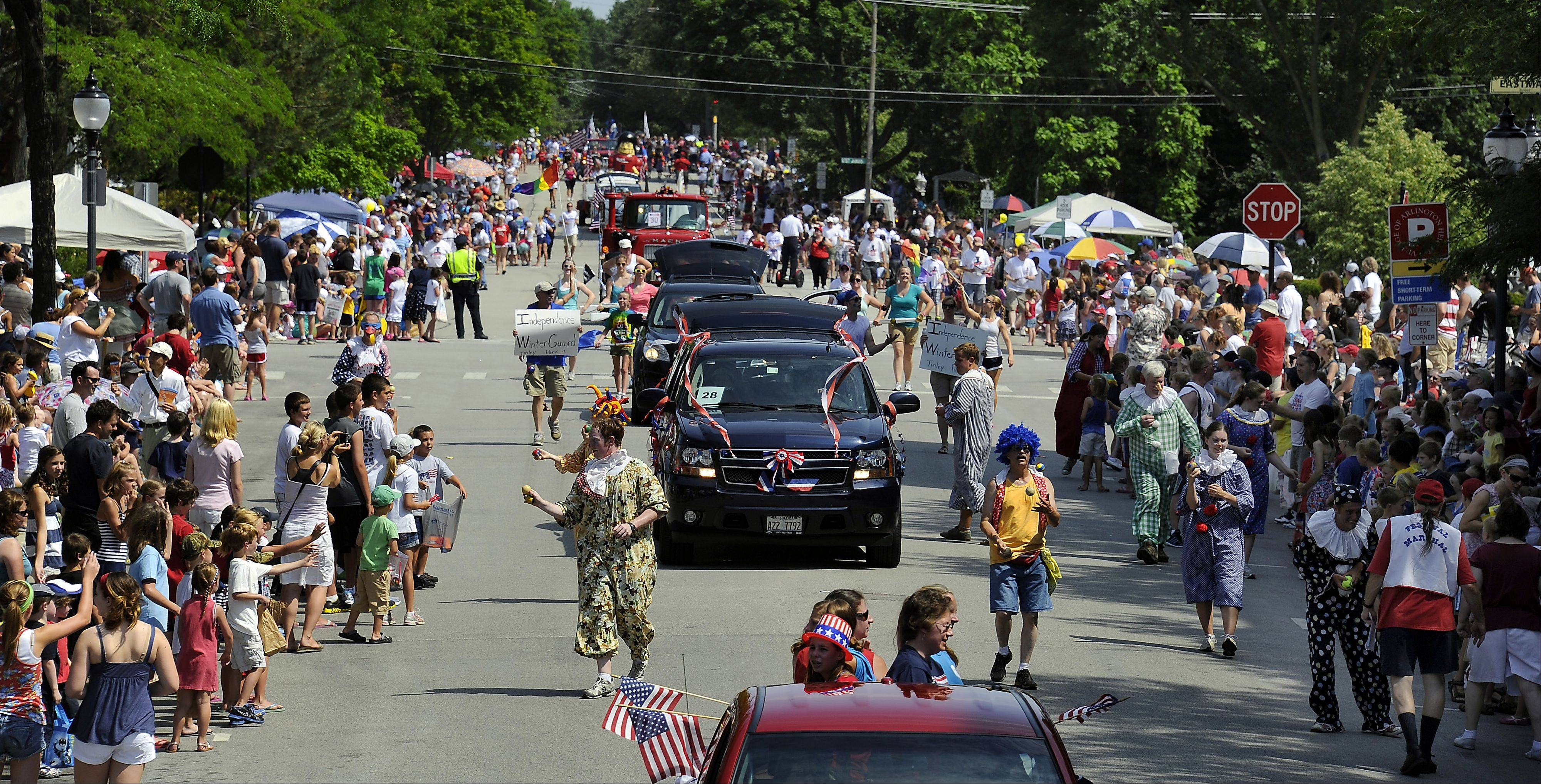 A mass of humanity floods the streets during the Fourth of July parade on Wednesday in Arlington Heights.