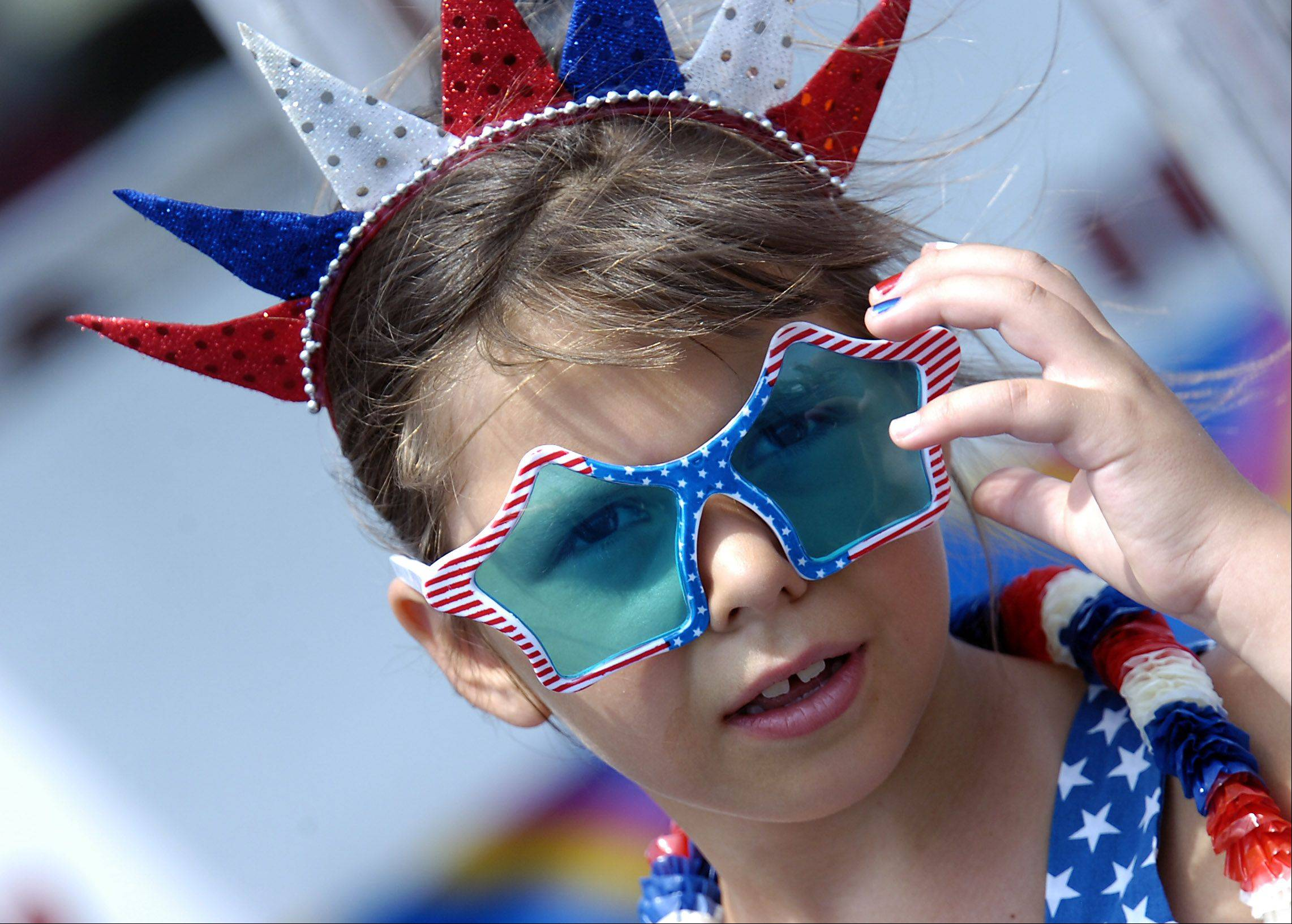 Eliza Incledon, 7, of South Barrington, shows her cool colors in the extreme heat which kept many people away from the first Hoffman Estates Northwest Fourth Fest held at the Sears Centre Arena on Wednesday.