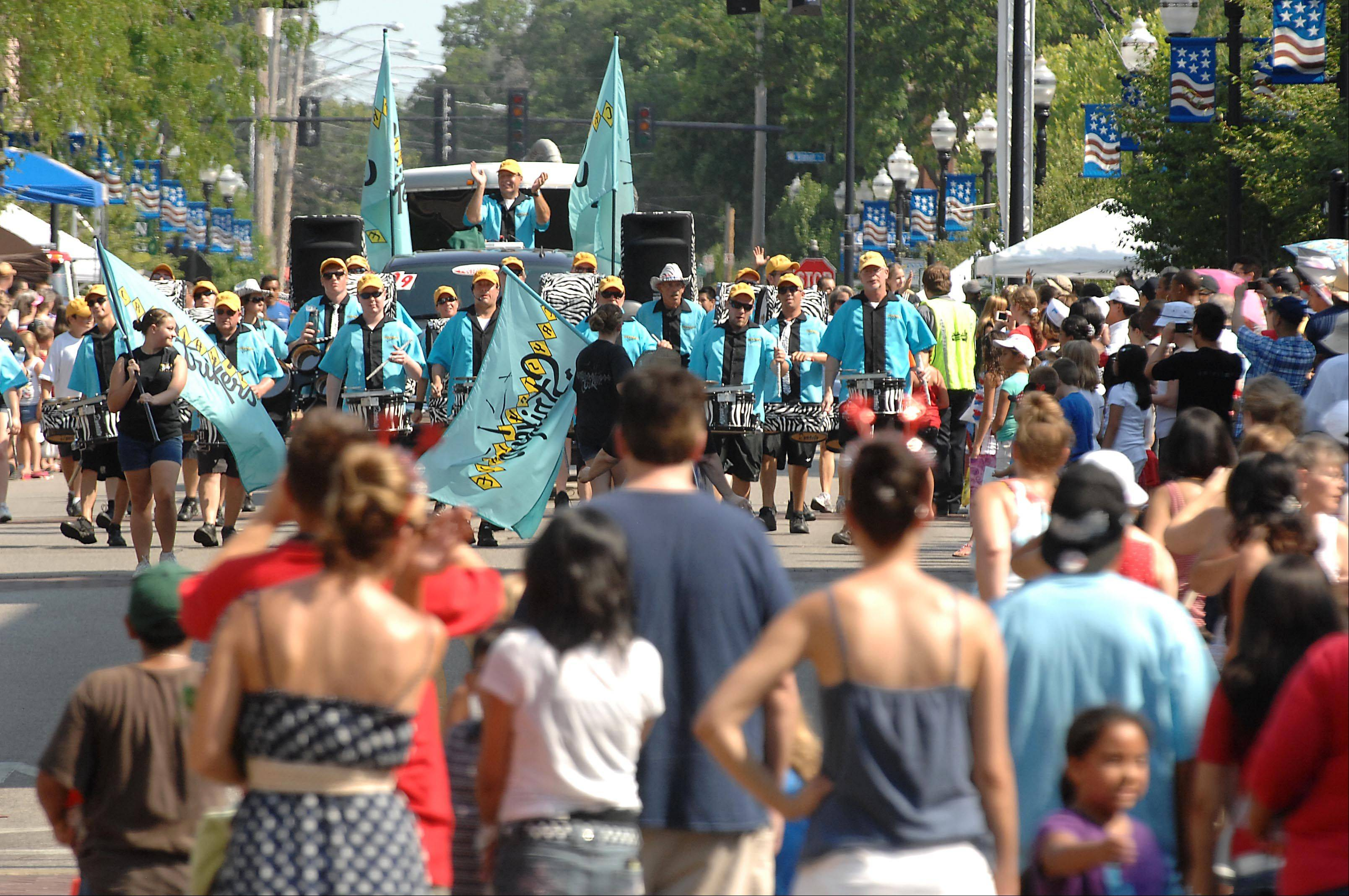 The Crystal Lake Strikers Drumline marching percussion unit performs Wednesday at Elgin Fourth of July parade.