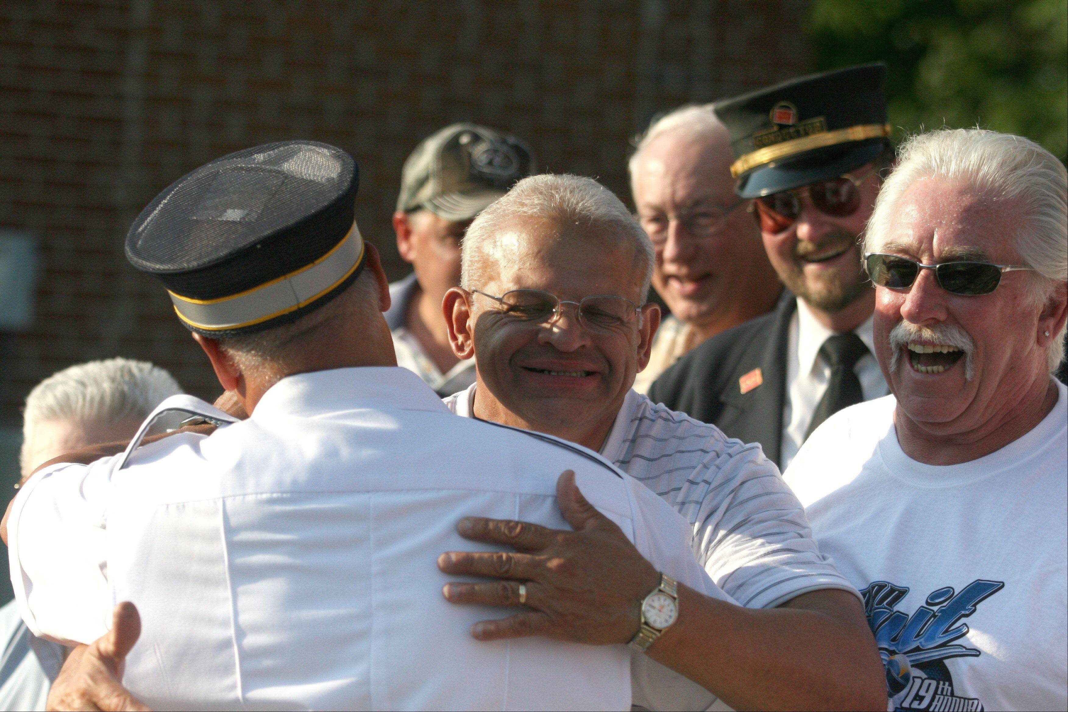 Metra engineer Hector Feliciano of Genoa embraces his brother Ralph of Elgin after piloting a train for the final time upon arrival at the Chicago Street Station in Elgin on Tuesday evening. Hector Feliciano retired after 42 years of service. Ralph is a conductor with Metra.