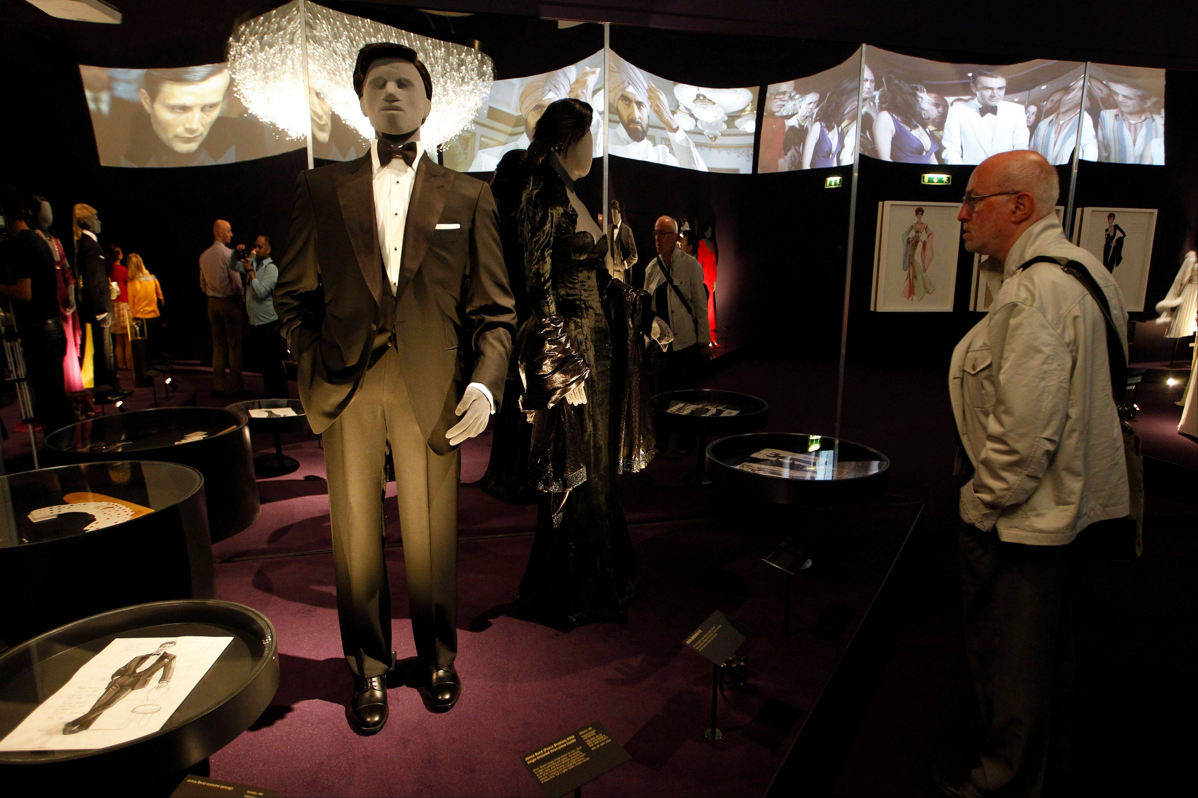 A visitor looks at a tuxedo worn by James Bond actor, Pierce Brosnan, in the film 'GoldenEye' on display in the exhibition 'Designing 007 - Fifty Years of Bond Style' at the Barbican centre in London.