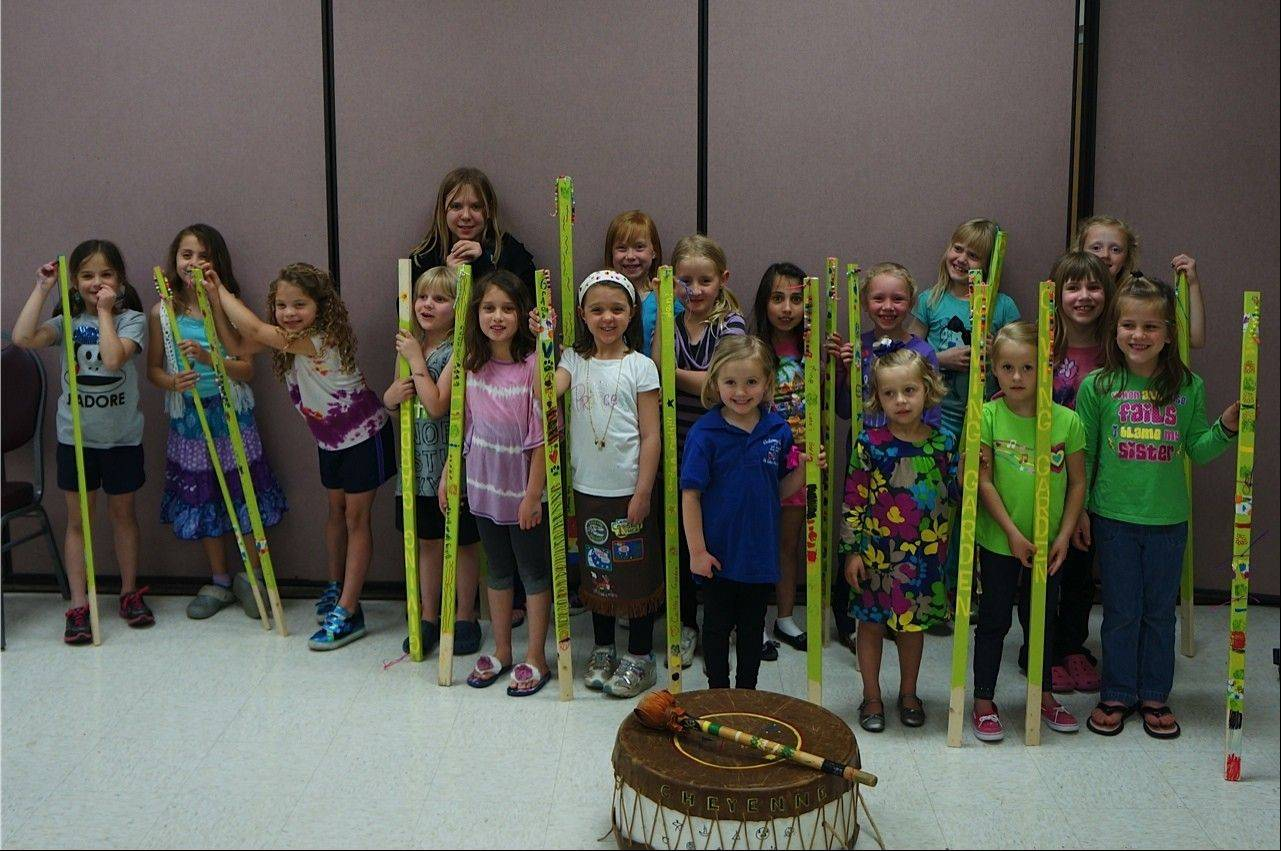 Cheyenne Indian Princesses tribe decorated stakes and took home free plants to nurture fresh vegetables to be donated to food pantries.