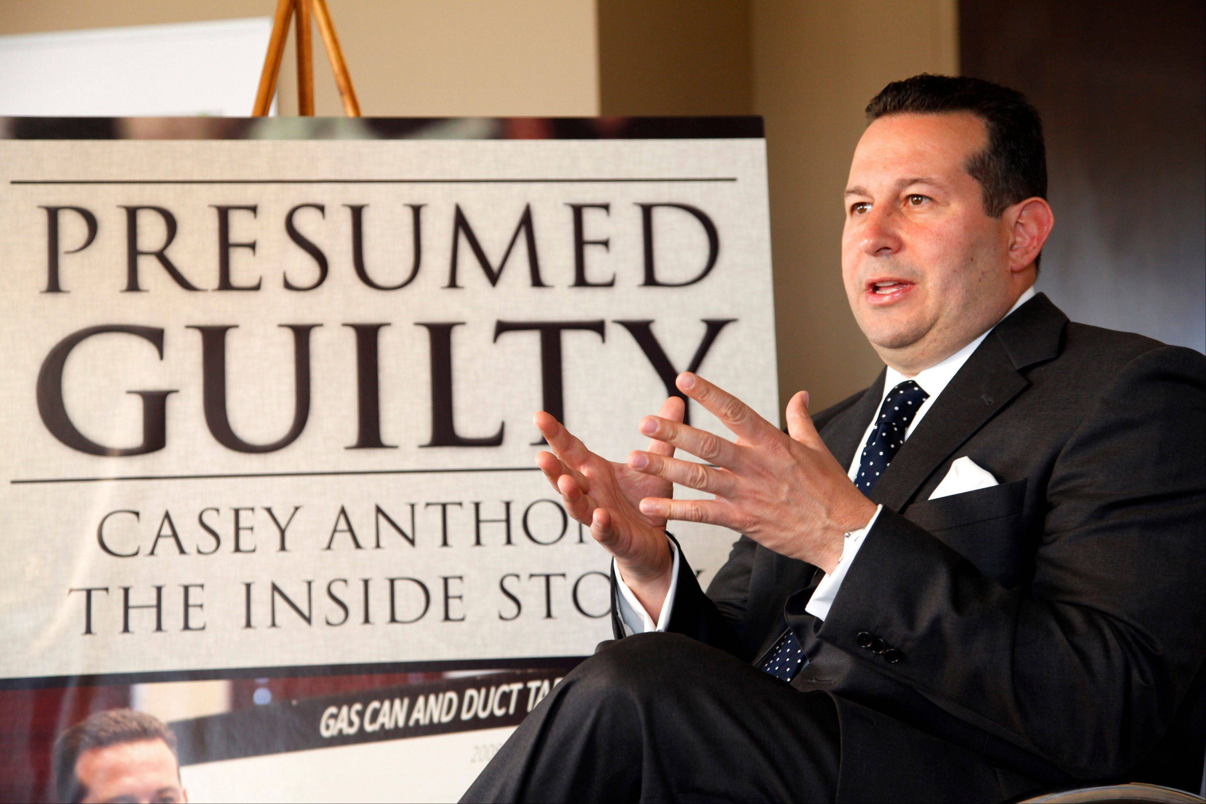 "Casey Anthony's defense attorney, Jose Baez, gestures as he speaks during an interview with The Associated Press in Coral Gables, Fla. In his just-published book ""Presumed Guilty, Casey Anthony: The Inside Story,"" Baez said prosecutors offered in 2008 to allow Anthony to plead guilty to aggravated manslaughter of a child and serve up to 13 years in prison. Baez said that in those early days he thought taking it might be in Anthony's best interest."