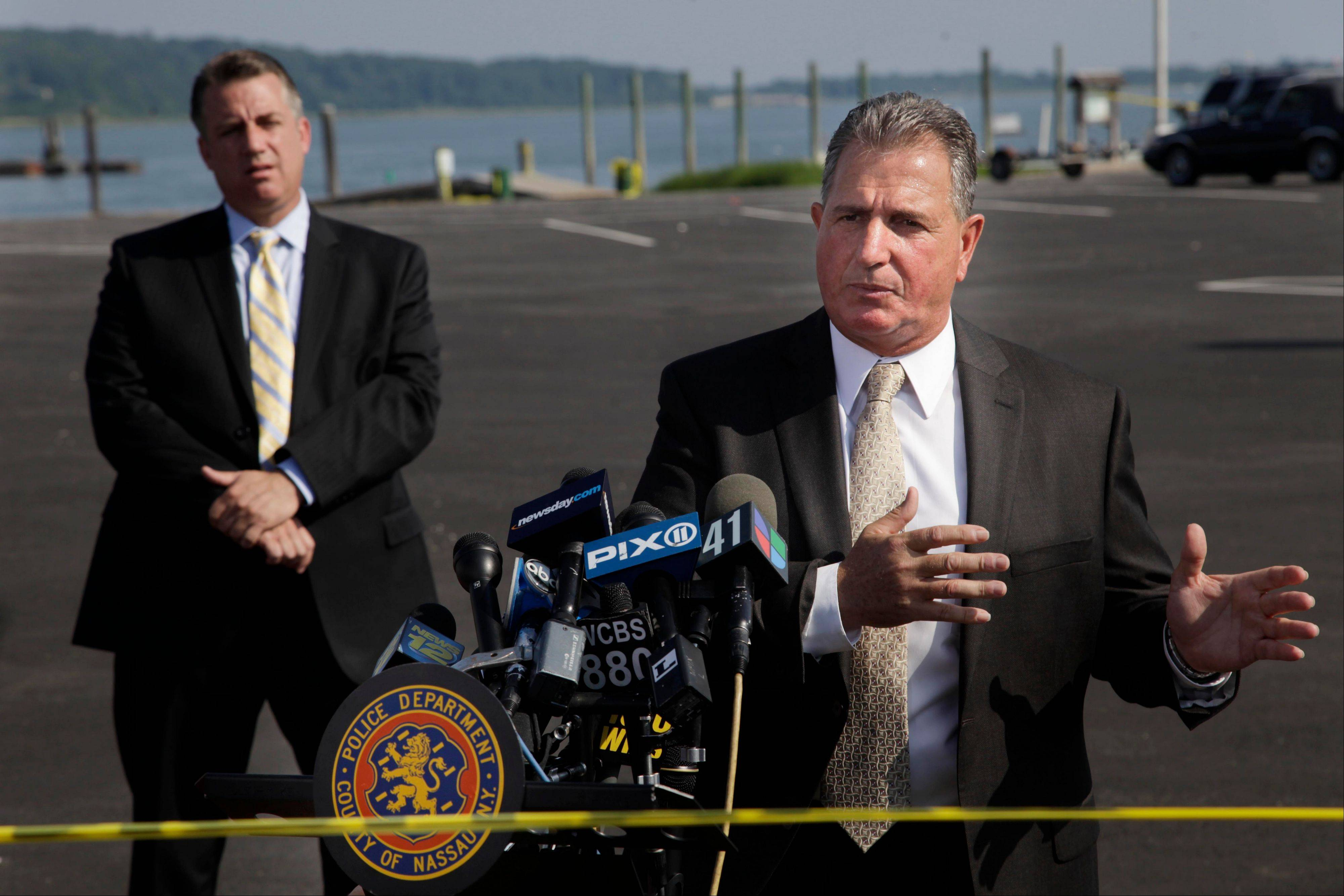 Nassau County Police Det. Lt. John Azzata, right, gives information about a fatal boating accident during a news conference in Oyster Bay, N.Y., Thursday, July 5, 2012. Police say three bodies have been pulled out of New York's Long Island Sound after a yacht capsized on the Fourth of July Police say three bodies pulled out of New York's Long Island Sound after a yacht capsized were all children. The bodies of the 12-year-old boy and two girls, ages 11 and 8, were recovered from the boat's cabin. Twenty-four other people were rescued, and were treated and released.