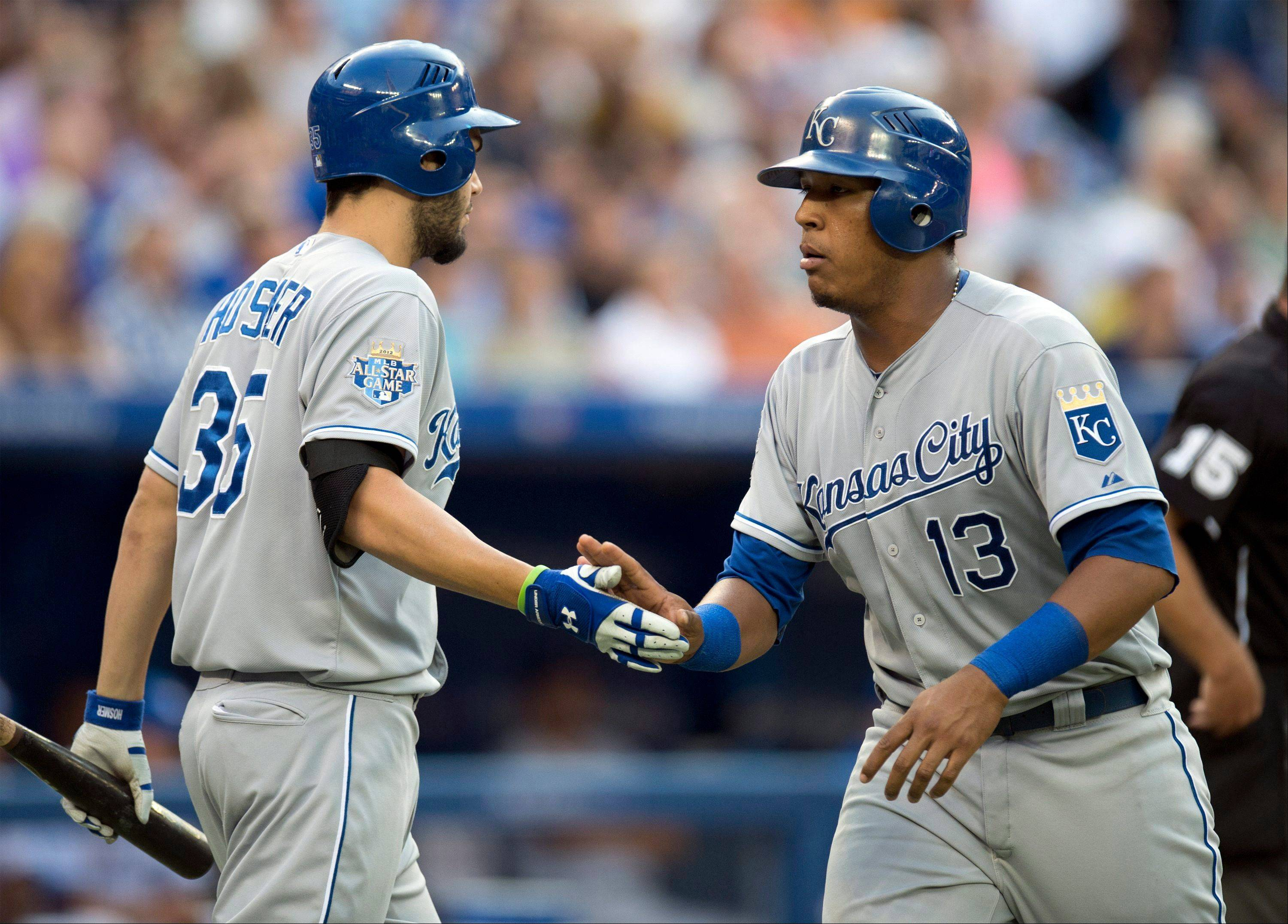 The Kansas City Royals Salvador Perez (right) is congratulated by teammate Eric Hosmer Thursday after scoring during the third inning against the Toronto Bluejays in Toronto.