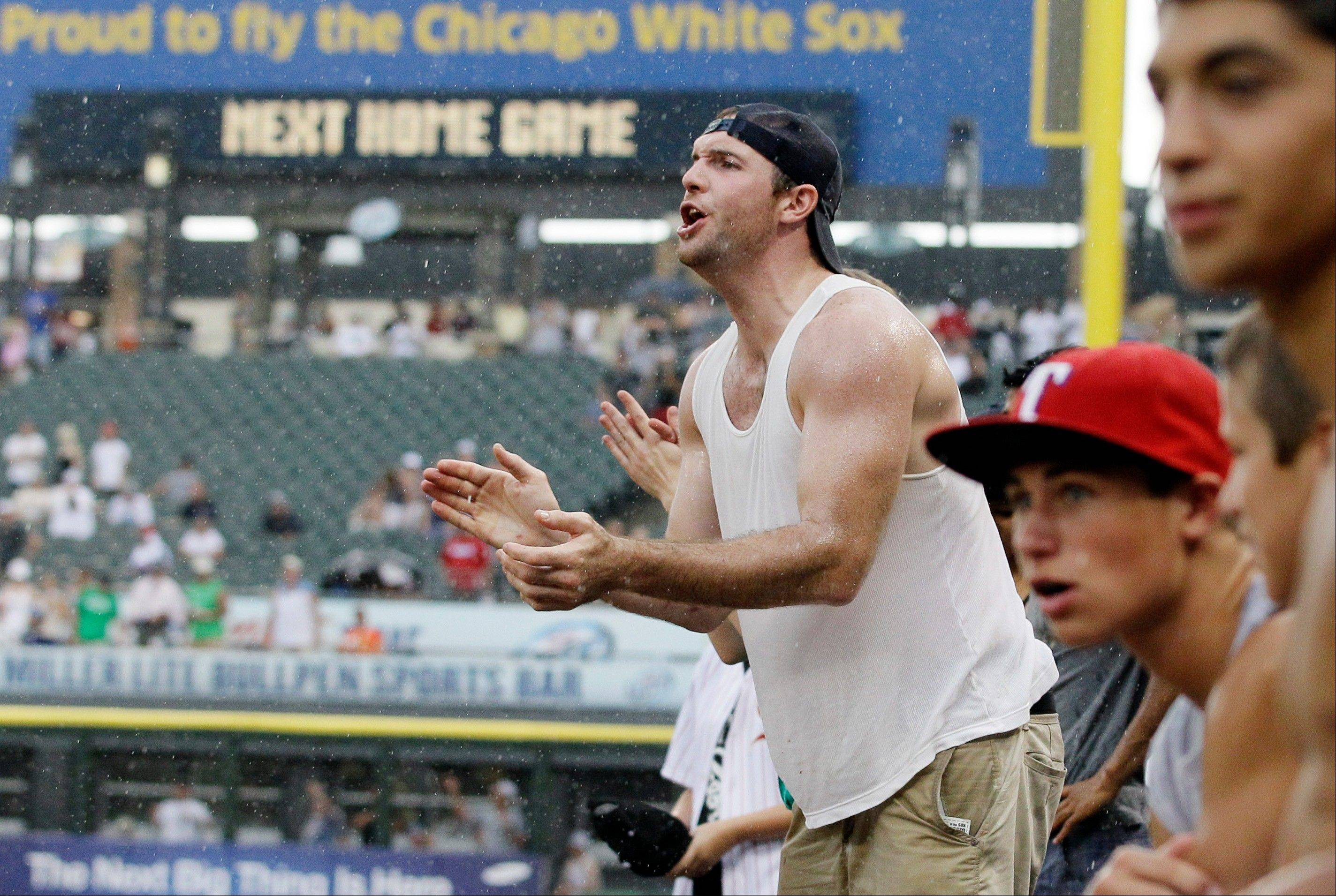 With temperatures topping 100 degrees, a White Sox fan still had the energy to get on his feet in the ninth inning as the Sox held on to beat the Texas Rangers 2-1 Thursday and sweep the club with the best record in baseball.