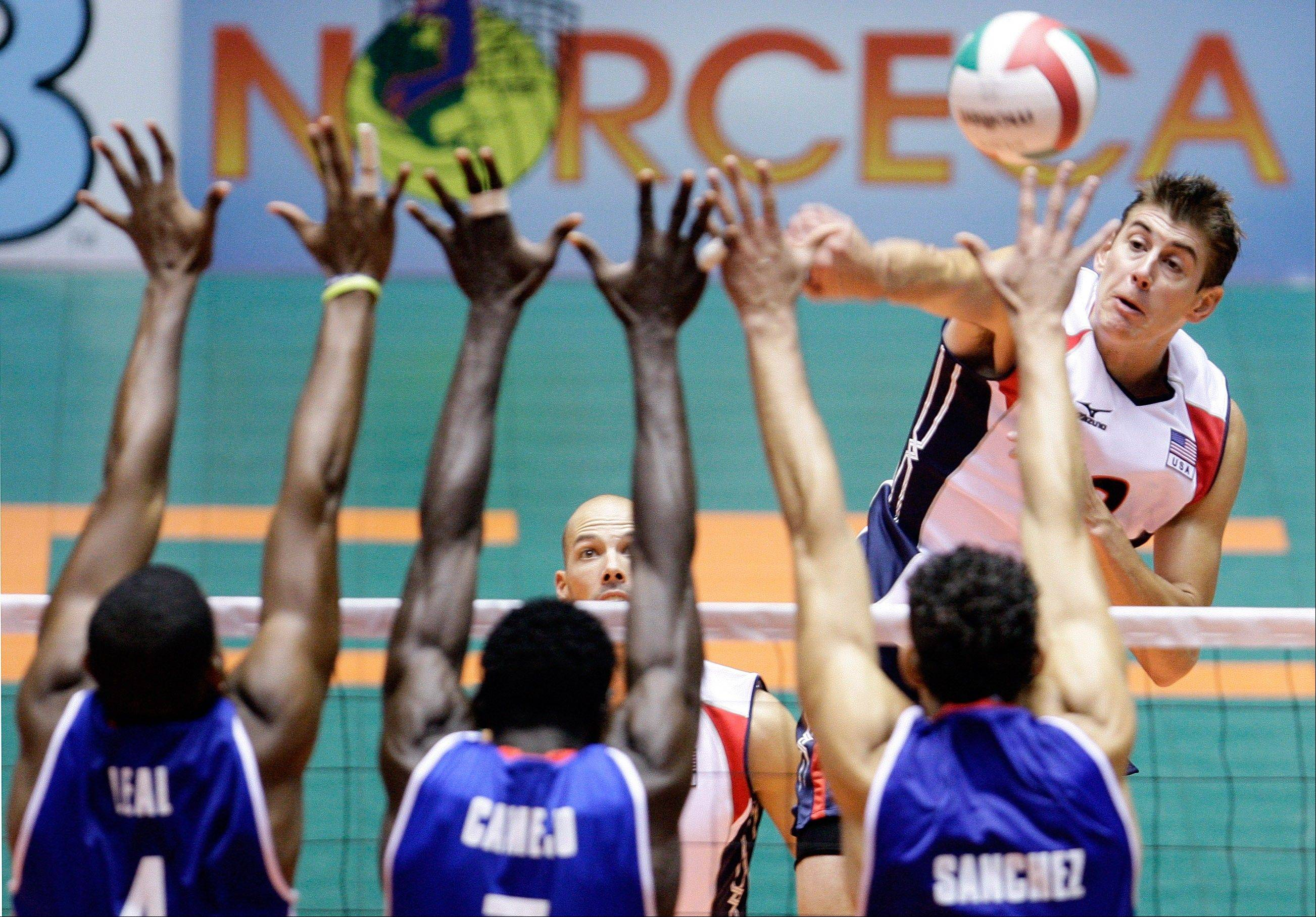 USA outside hitter Sean Rooney of Wheaton, here smashing a shot in an international match, has been named to his second Olympic team.