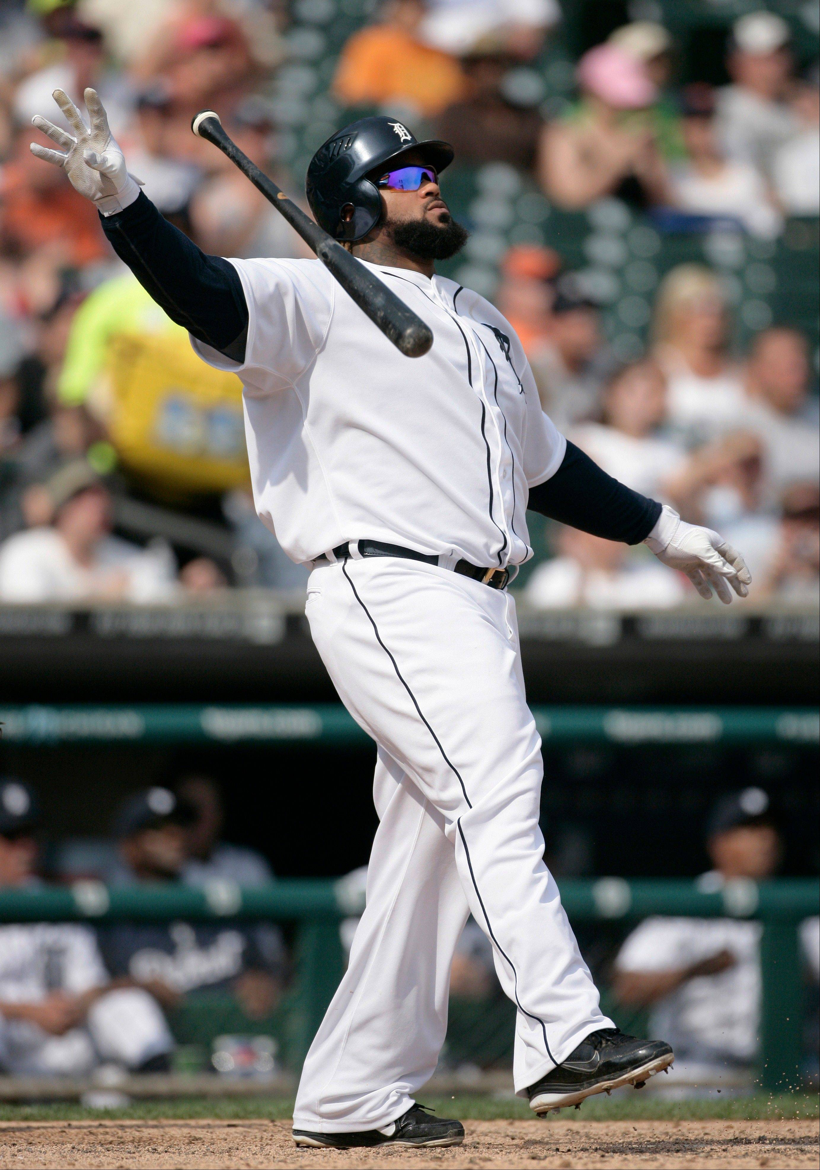 Detroit Tigers first baseman Prince Fielder watches his three-run home run that broke a 3-3 tie in the eighth inning against the Minnesota Twins in Detroit. The Tigers defeated the Twins 7-3.