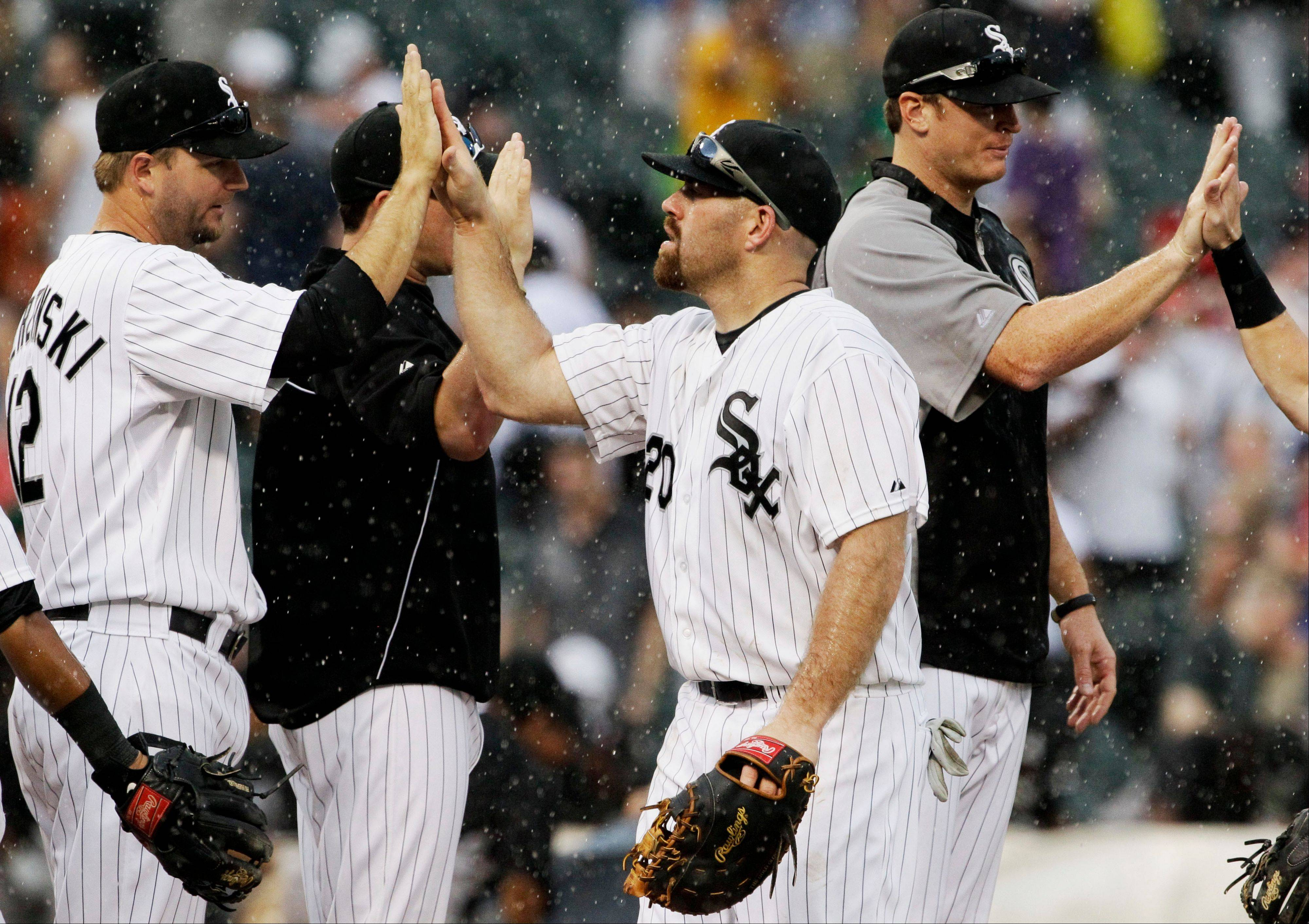 Kevin Youkilis, front right, celebrates with A.J. Pierzynski, left, after the White Sox defeated the Texas Rangers 2-1 Thursday. Mike North contends Pierzynski may be the most important player on the Sox in the second half of the season.