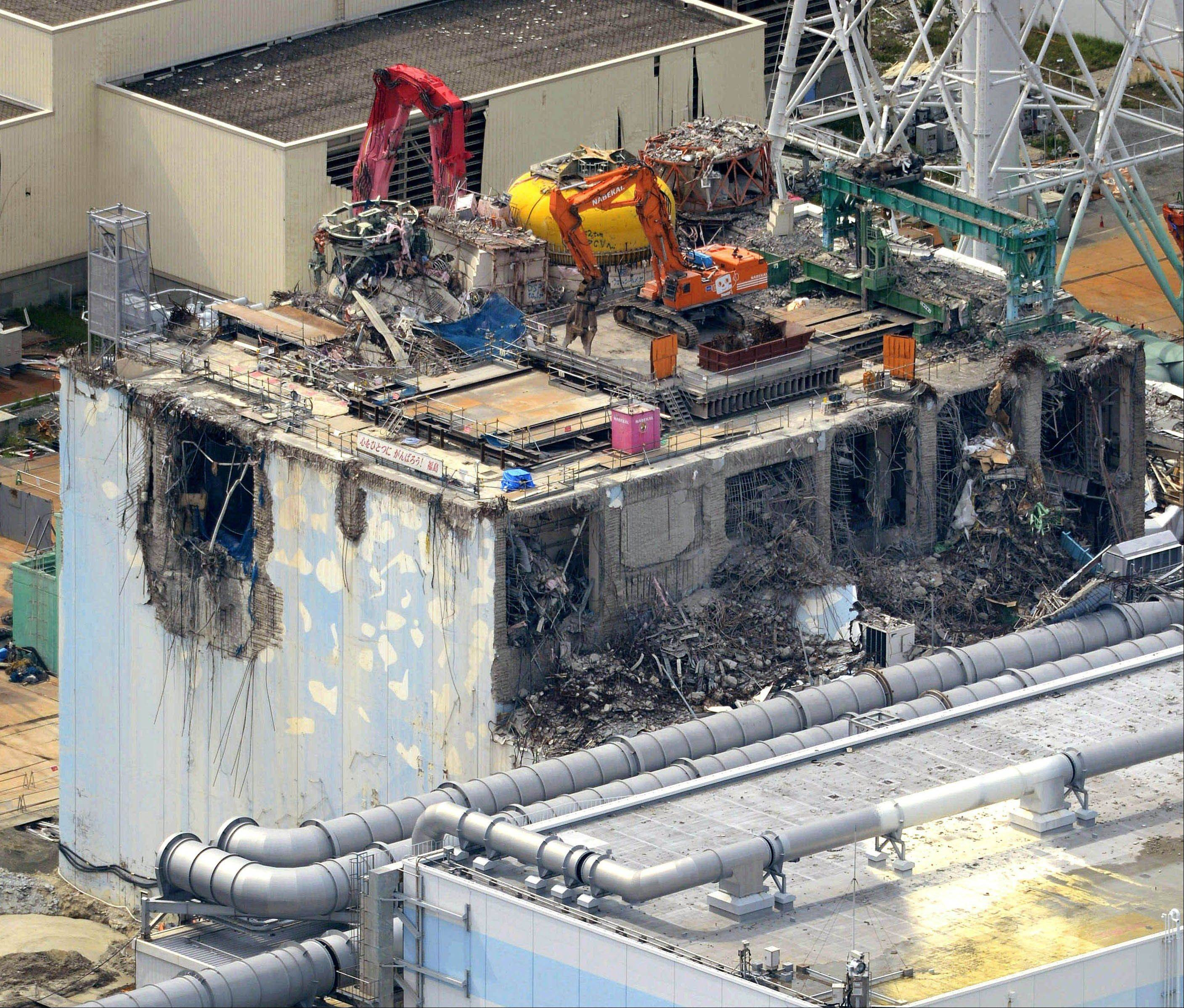 The rubble is removed from the damaged No. 4 reactor building at Tokyo Electric Power Co.'s tsunami-crippled Fukushima Dai-ichi nuclear power plant in Okuma town, Fukushima prefecture, northeastern Japan, Thursday.