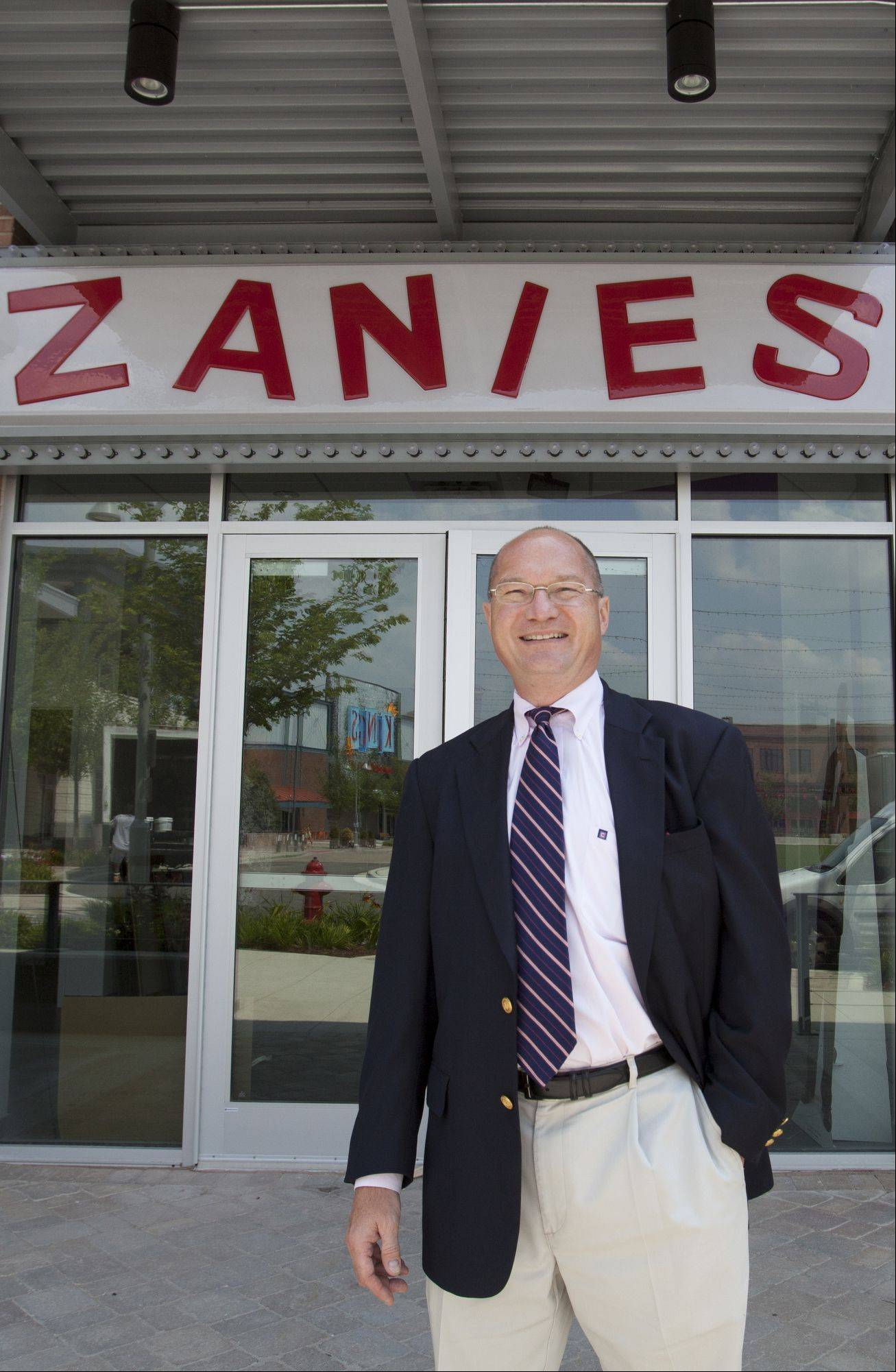 Executive Vice President Bert Haas stands in front of the new Zanies in Rosemont, which opens July 6.