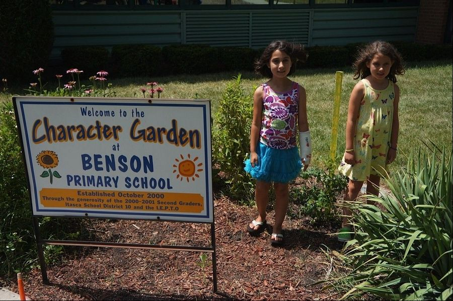 Marty Lundeen of Itasca, along with his daughters, Stella, left, and Margo, talked with leaders at Benson Elementary School about growing vegetables in a Given Garden program.