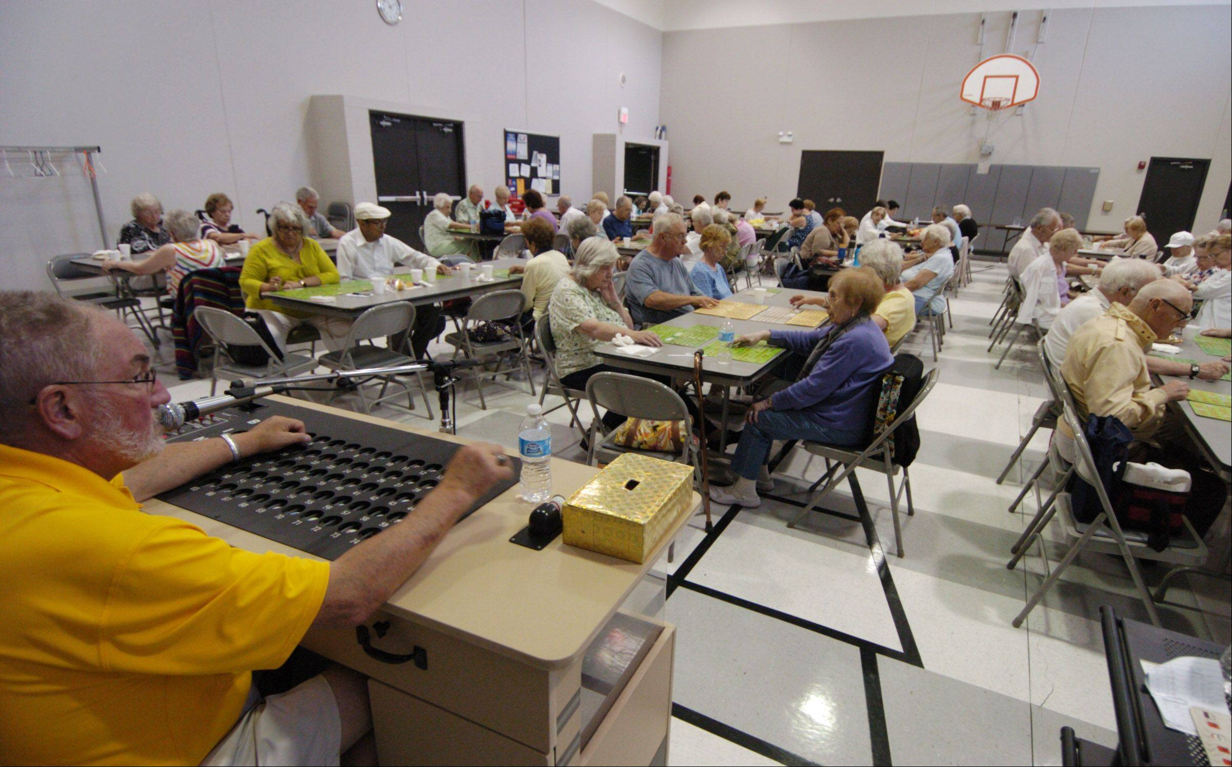 Schaumburg Park District Commissioner Bob Schmidt calls bingo numbers for seniors playing at the Schaumburg Township Hall Thursday.