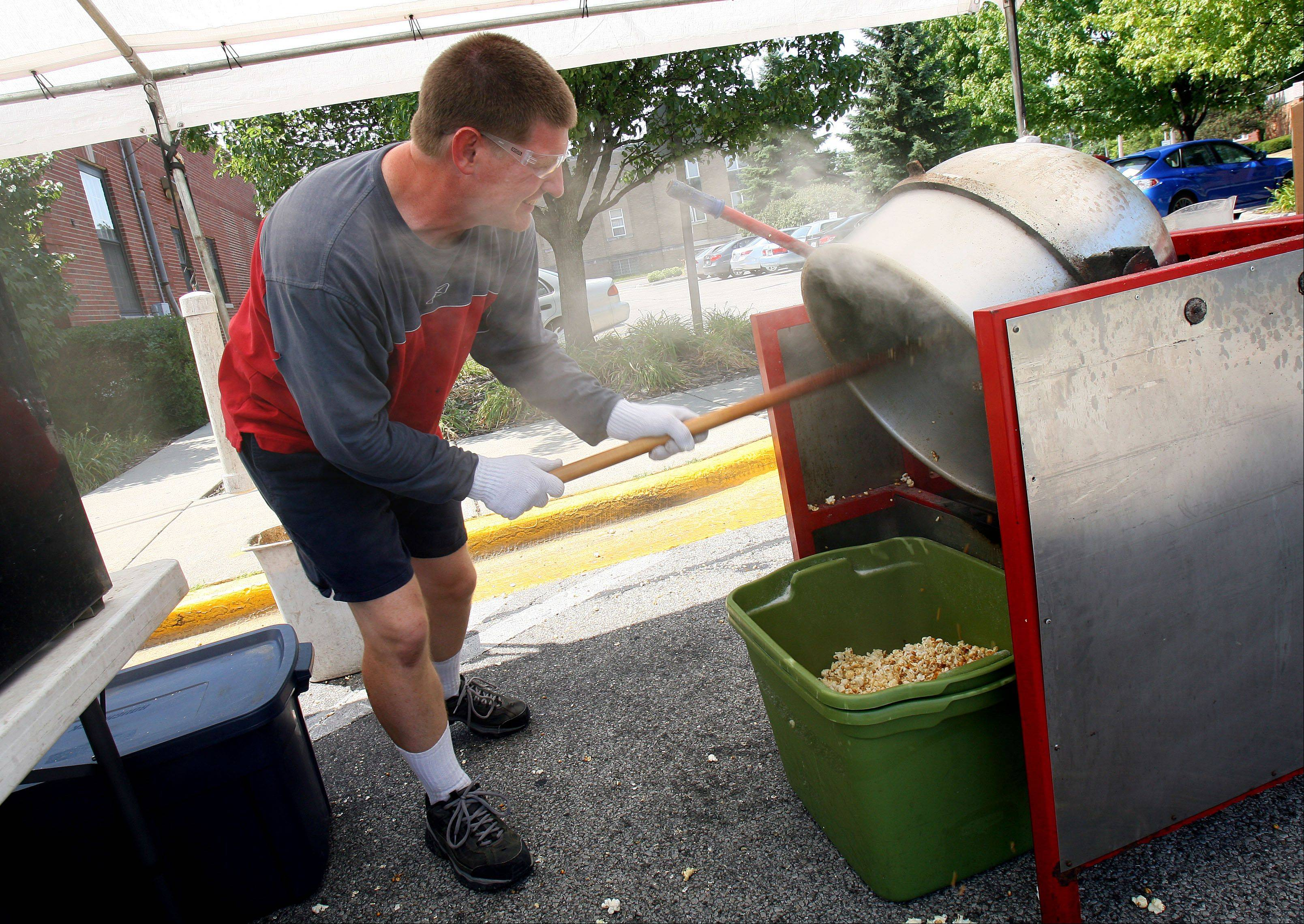 Greg Rosenquist of Dwight has the unenviable task of making kettle corn at the Libertyvlle Farmers Market.