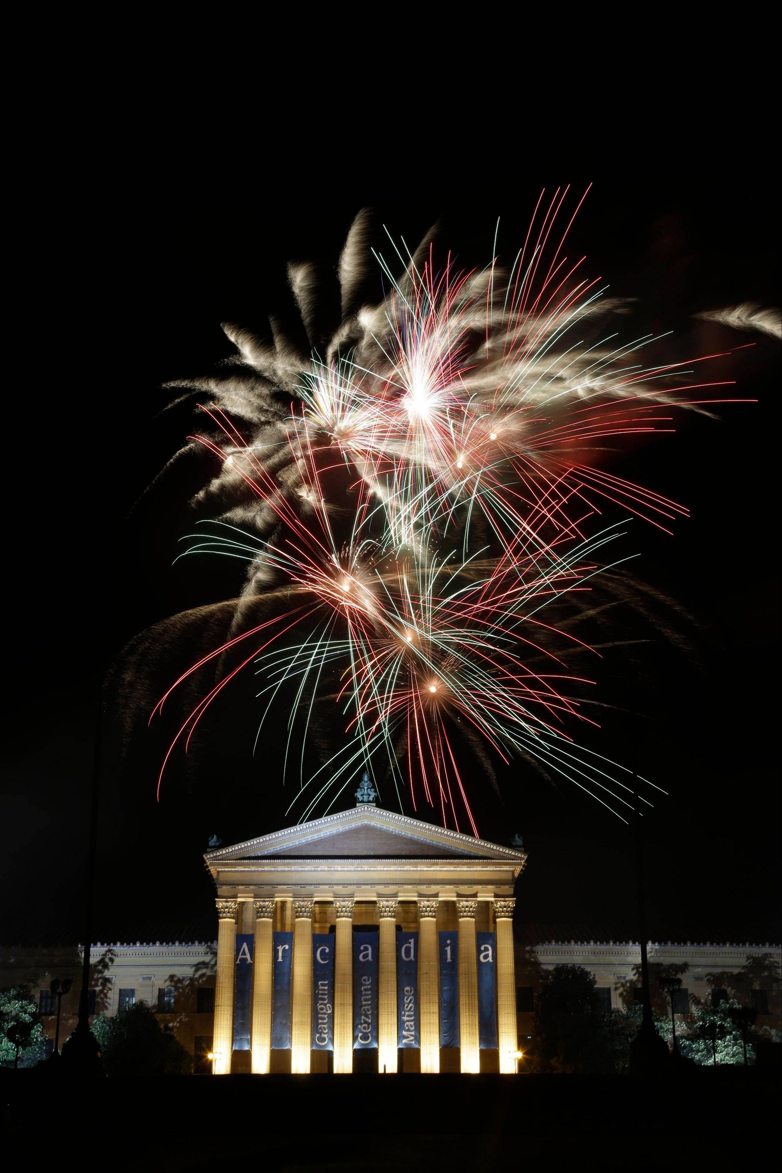Fireworks light up the sky over the Philadelphia Museum of Art during an Independence Day celebration, Wednesday, July 4, 2012, in Philadelphia.