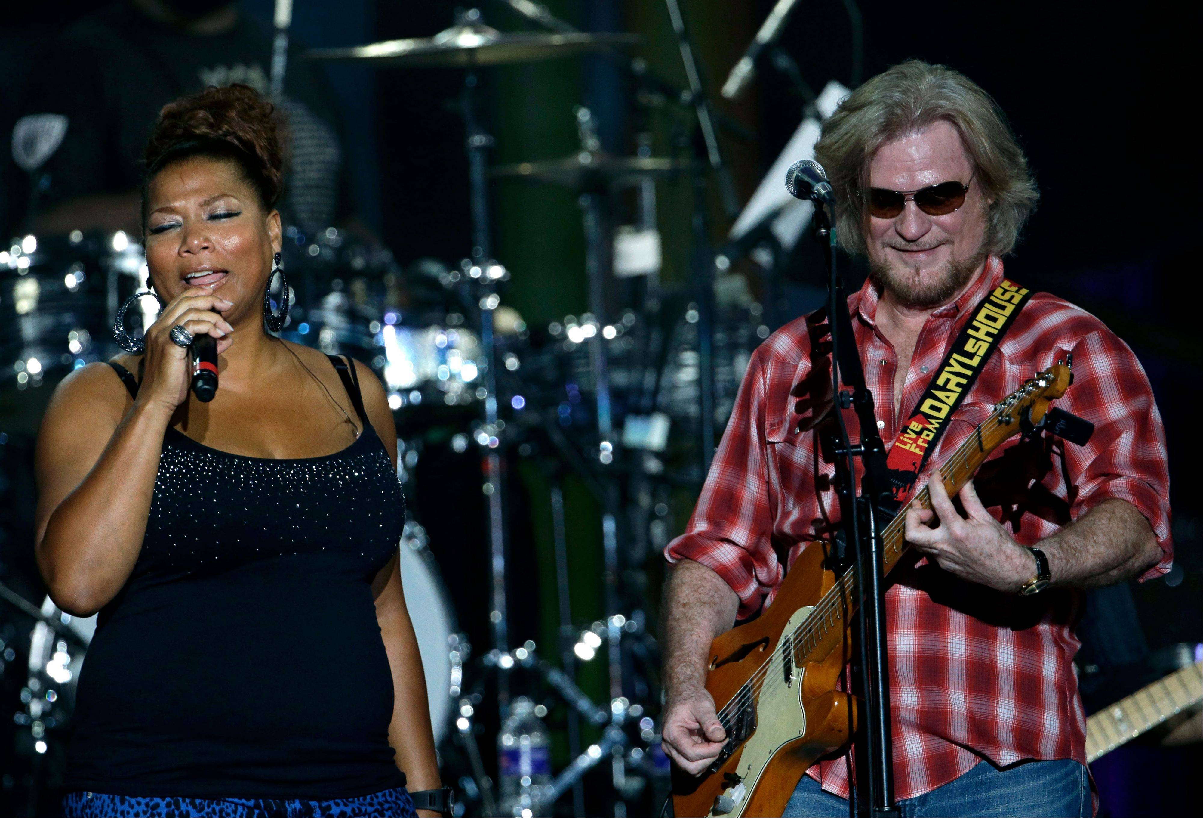 Daryl Hall performs with Queen Latifah during an Independence Day celebration, Wednesday, July 4, 2012, in Philadelphia.