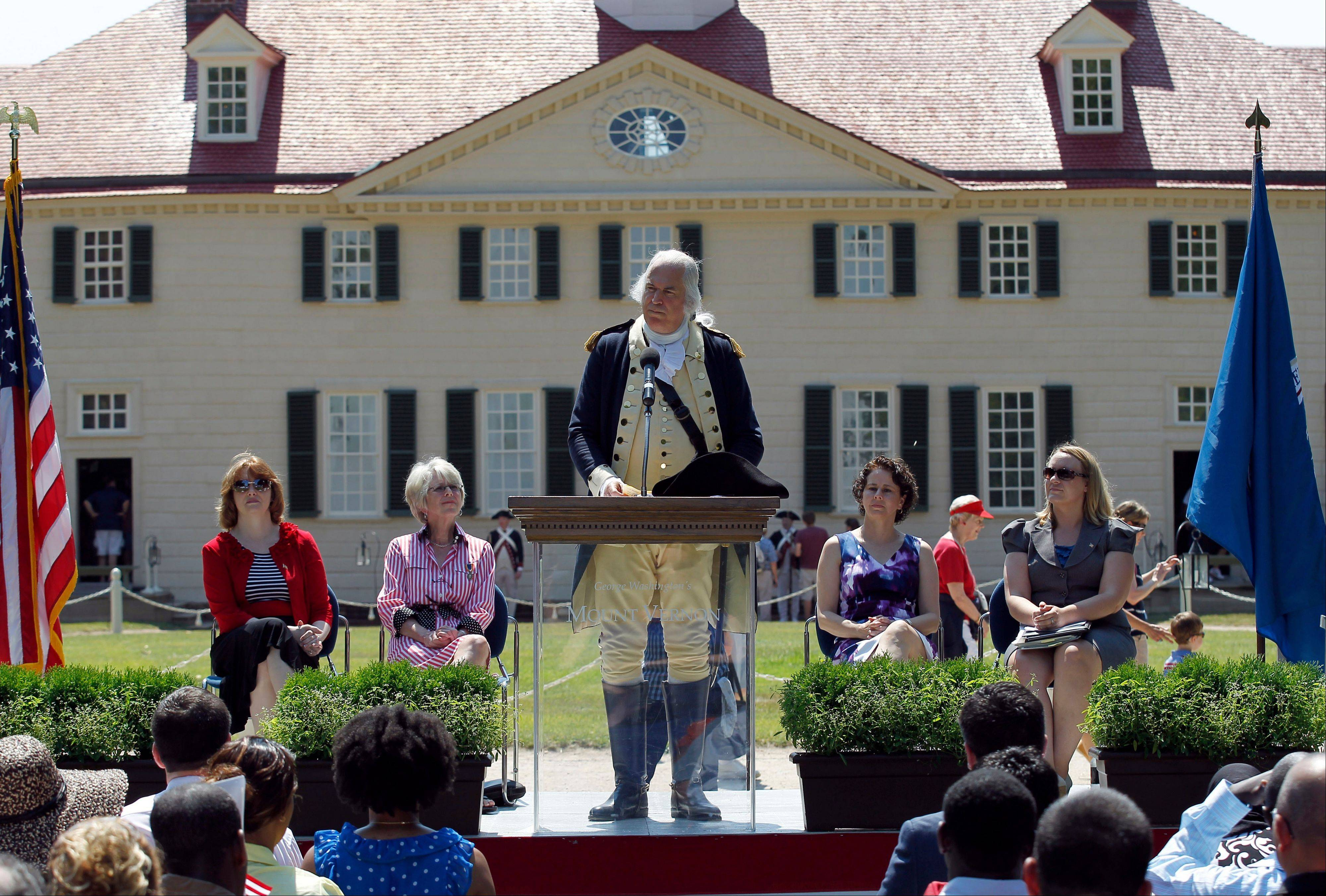 A re-enactor portraying Gen. George Washington speaks to candidates for naturalization during a naturalization ceremony at George Washington's Mount Vernon estate, Wednesday, July 4, 2012 in Alexandria, Va.