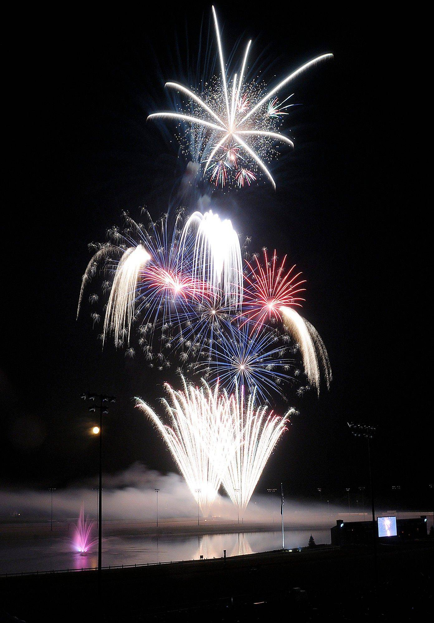 Fireworks fill the sky after a performance by the Anderson Symphony Orchestra at Hoosier Park Racing & Casino in Anderson, Ind. on Wednesday, July 4, 2012.