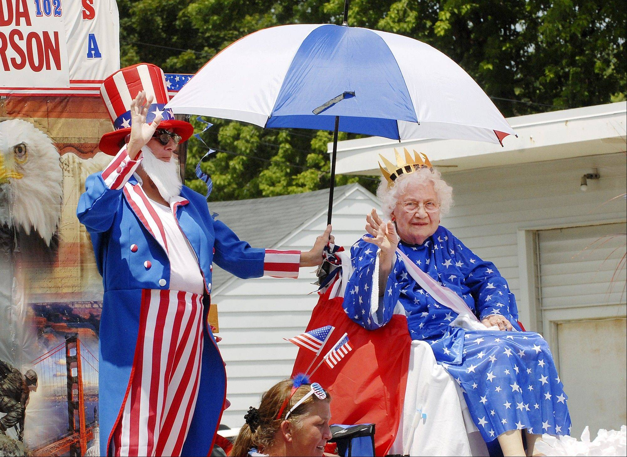 "Portraying ""Old Lady Liberty,"" Hilda Anderson, 102, rides a float in the Chesterfield Independence Day Parade in Chesterfield, Ind. on Wednesday, July 4, 2012."
