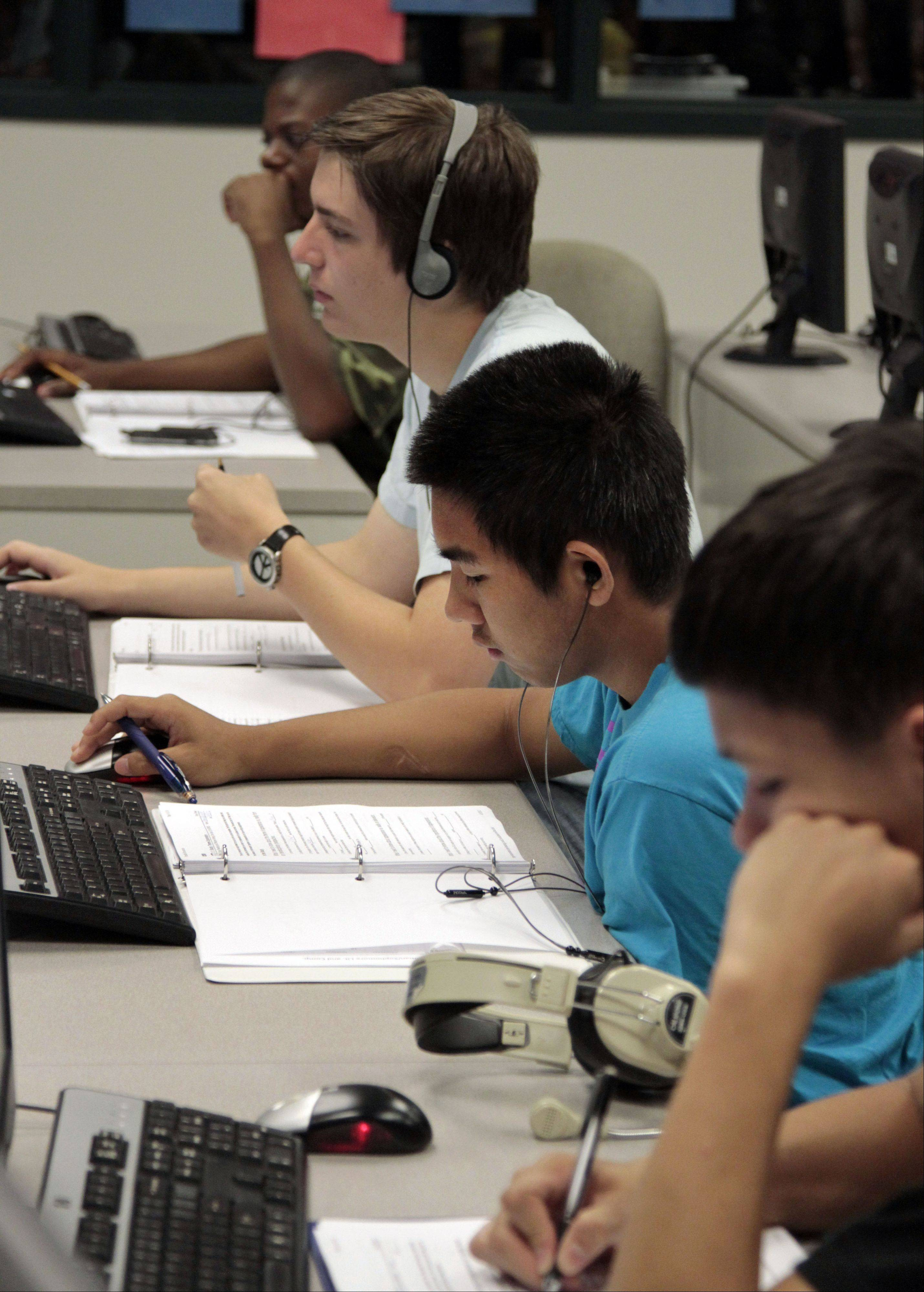 For the first time, online English classes are offered this summer at Vernon Hills High School. The students work in a computer lab at their own pace. Teachers are there to guide them, help when needed and occasionally step in with some group lessons.