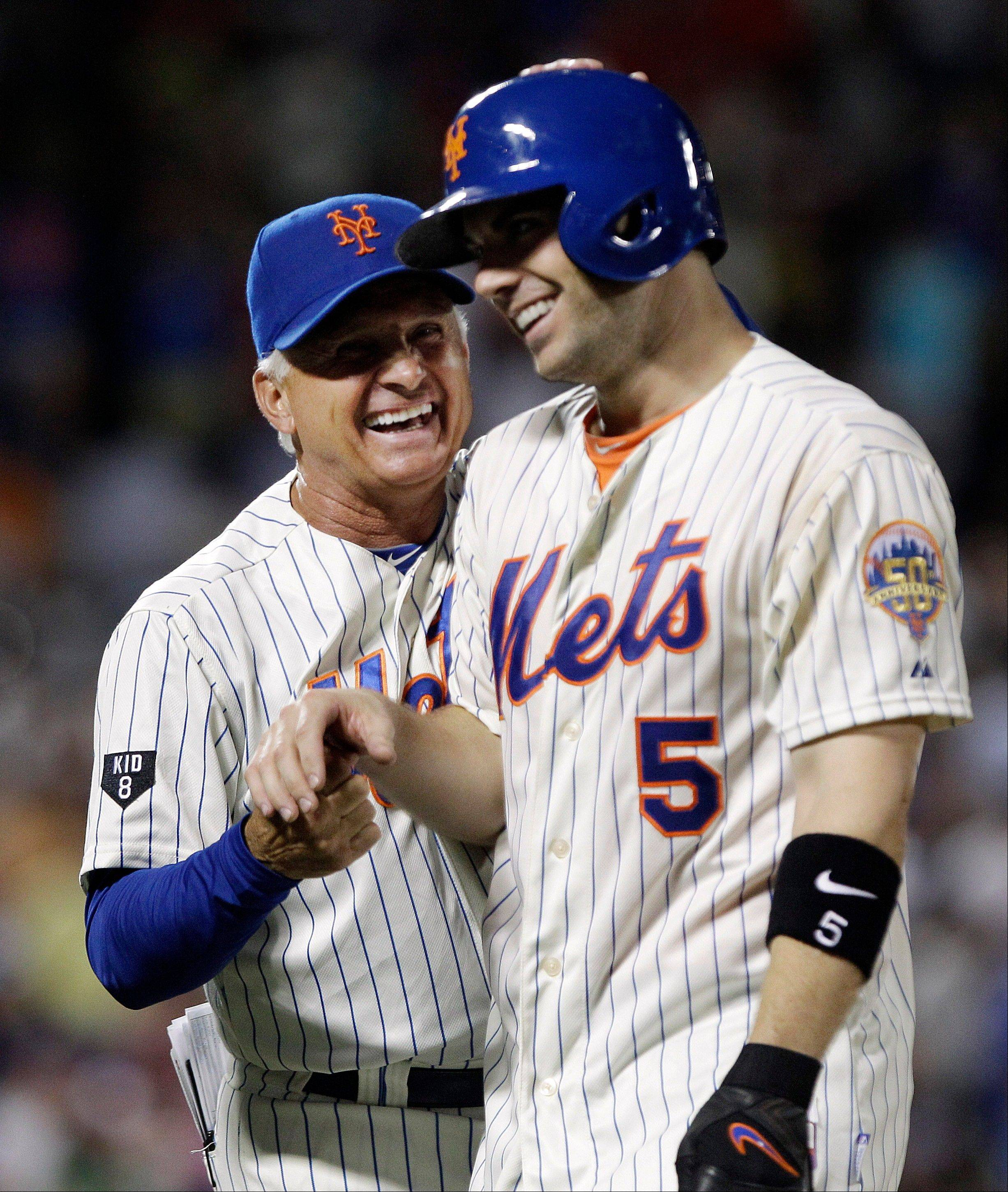 New York Mets manager Terry Collins, left, celebrates with David Wright after Wright drove in the game-winning run Thursday during the ninth inning against the Philadelphia Phillies in New York. The Mets won 6-5.