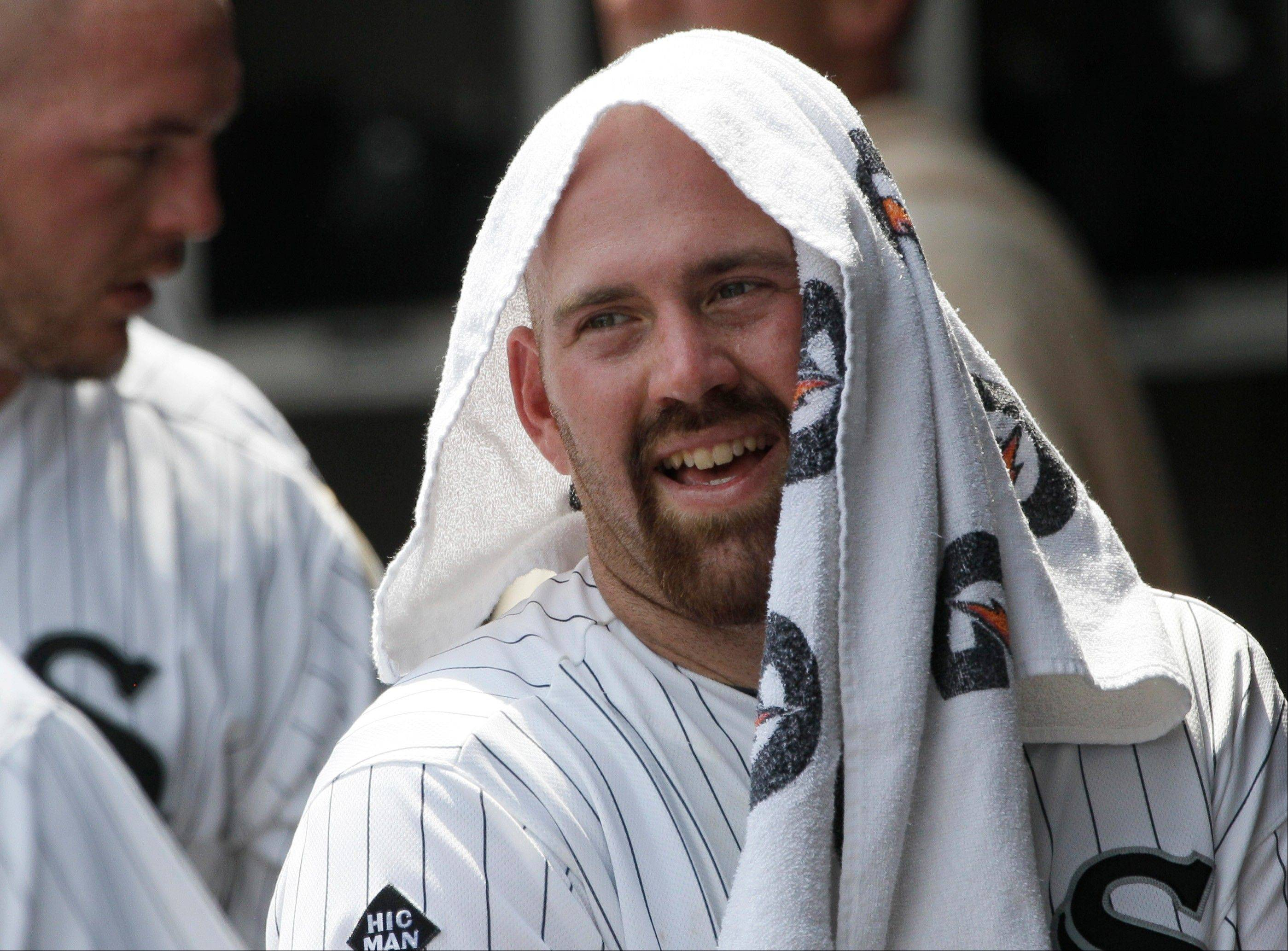 Kevin Youkilis smiles as he celebrates with teammates Thursday after hitting a solo home run during the sixth inning against the Texas Rangers at U.S. Cellular Field.