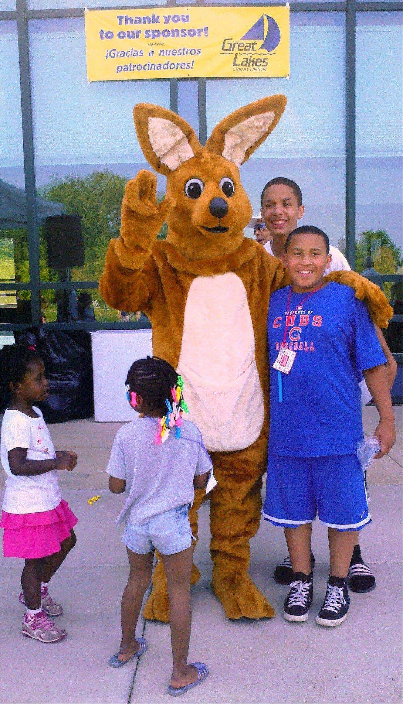 Kirby the Kangaroo, Great Lakes Credit Union's mascot, meets young people at the Kids Nature Funfest at the Greenbelt Cultural Center in North Chicago.