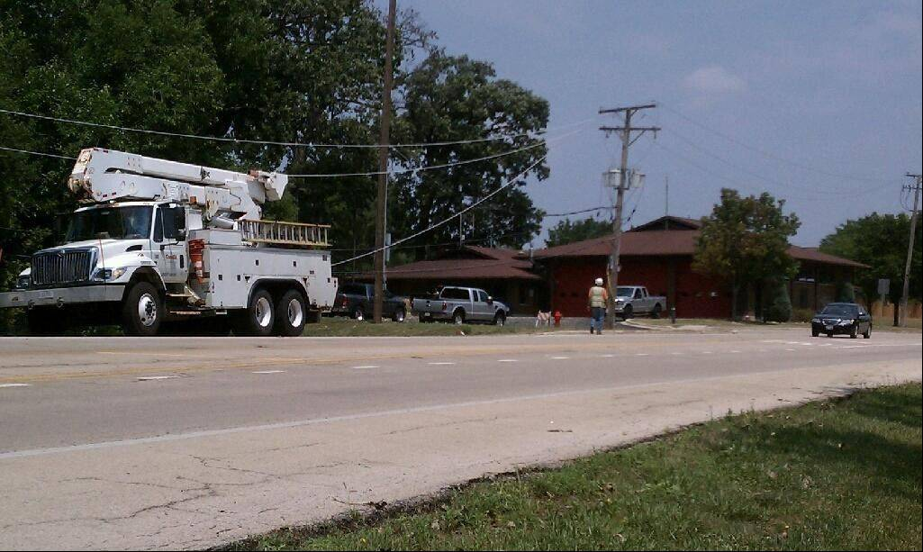 Crews clear downed power lines after a recent storms in Bartlett.