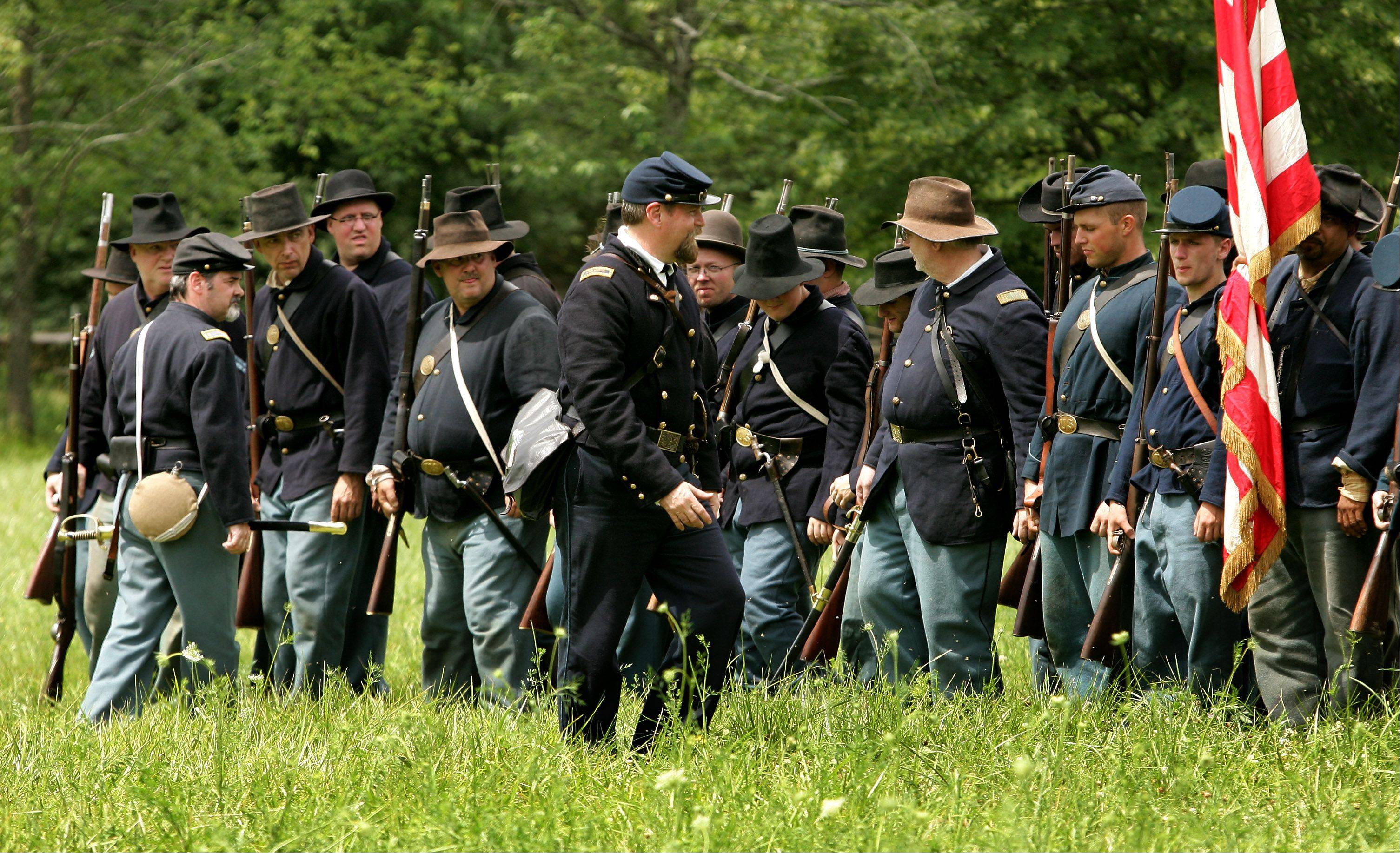 Bob Winter of Lombard runs the 1st Illinois Battalion Infantry through drills before the afternoon battle against the Confederates during last year's Civil War Days at Lakewood Forest Preserve near Wauconda.