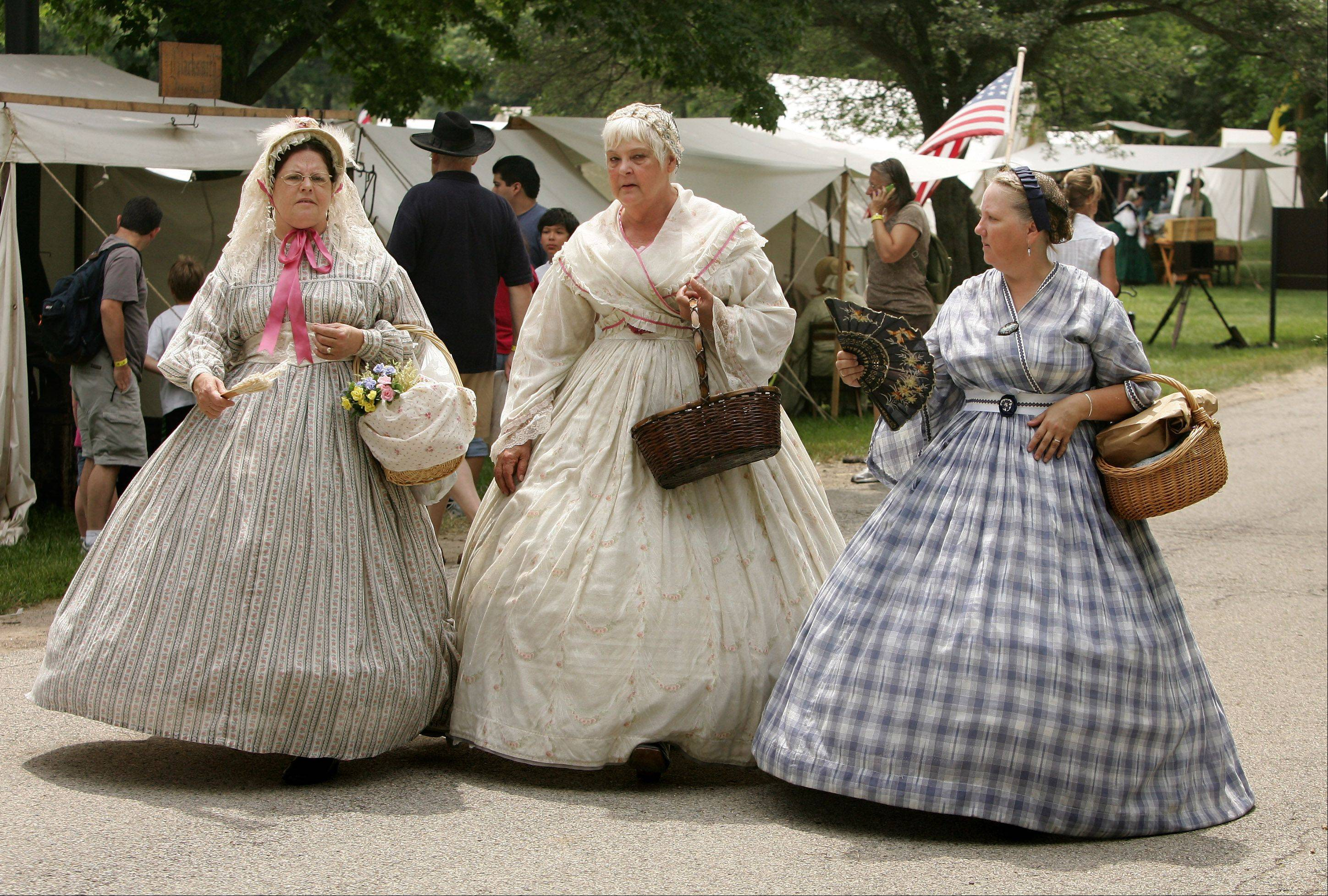 Rose Brown of Prospect Heights, left, Bobie Webber of Chicago, and Jill Pontillo of Lake Villa walk through camp during last year's Civil War Days at Lakewood Forest Preserve near Wauconda.