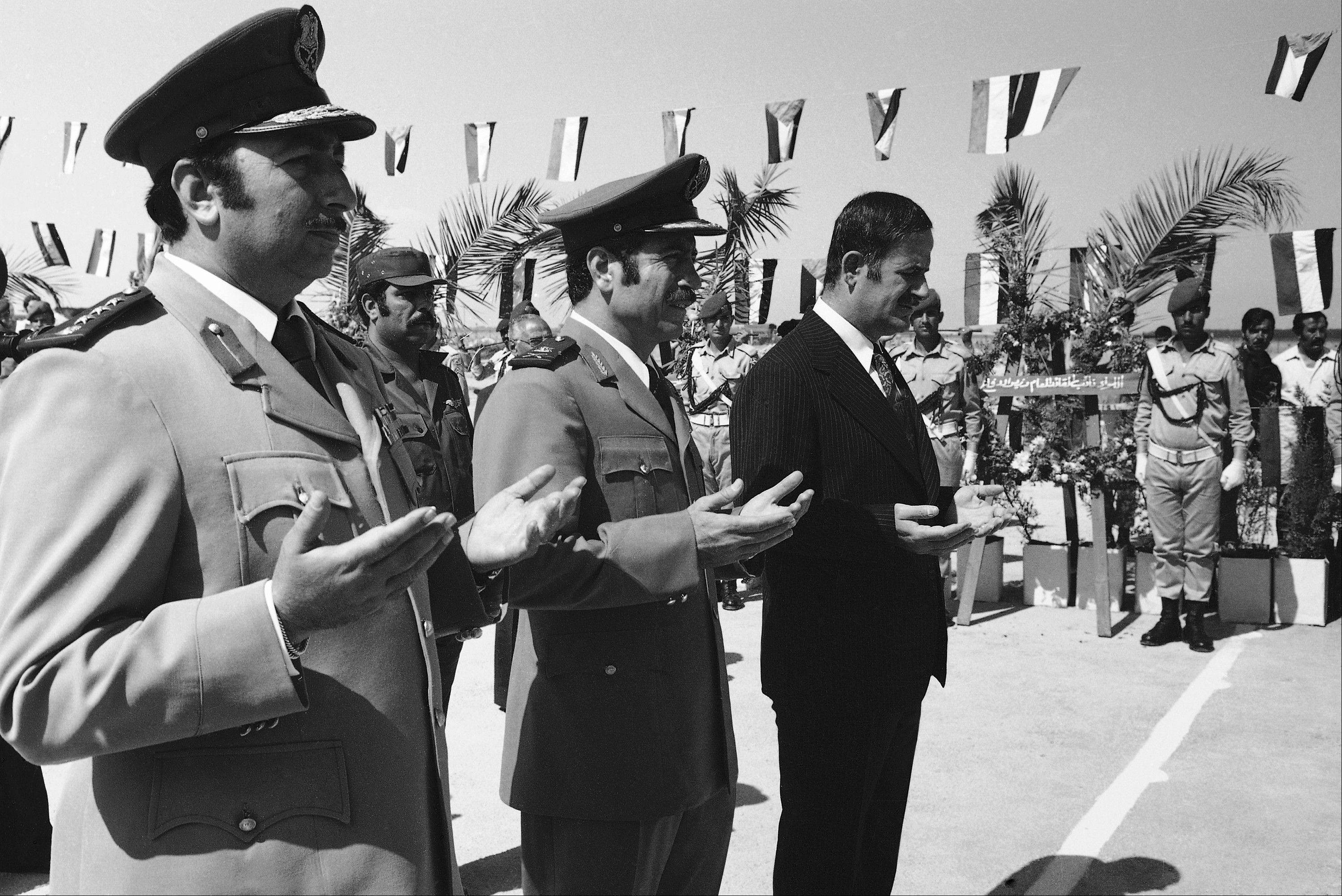 Associated Press/Oct. 6, 1974 Syrian President Hafez Assad, right, and Gen. Mustafa Tlass, then-war minister, center, take part in ceremonies in Damascus honoring Syrian dead on the first anniversary of the last war with Israel.