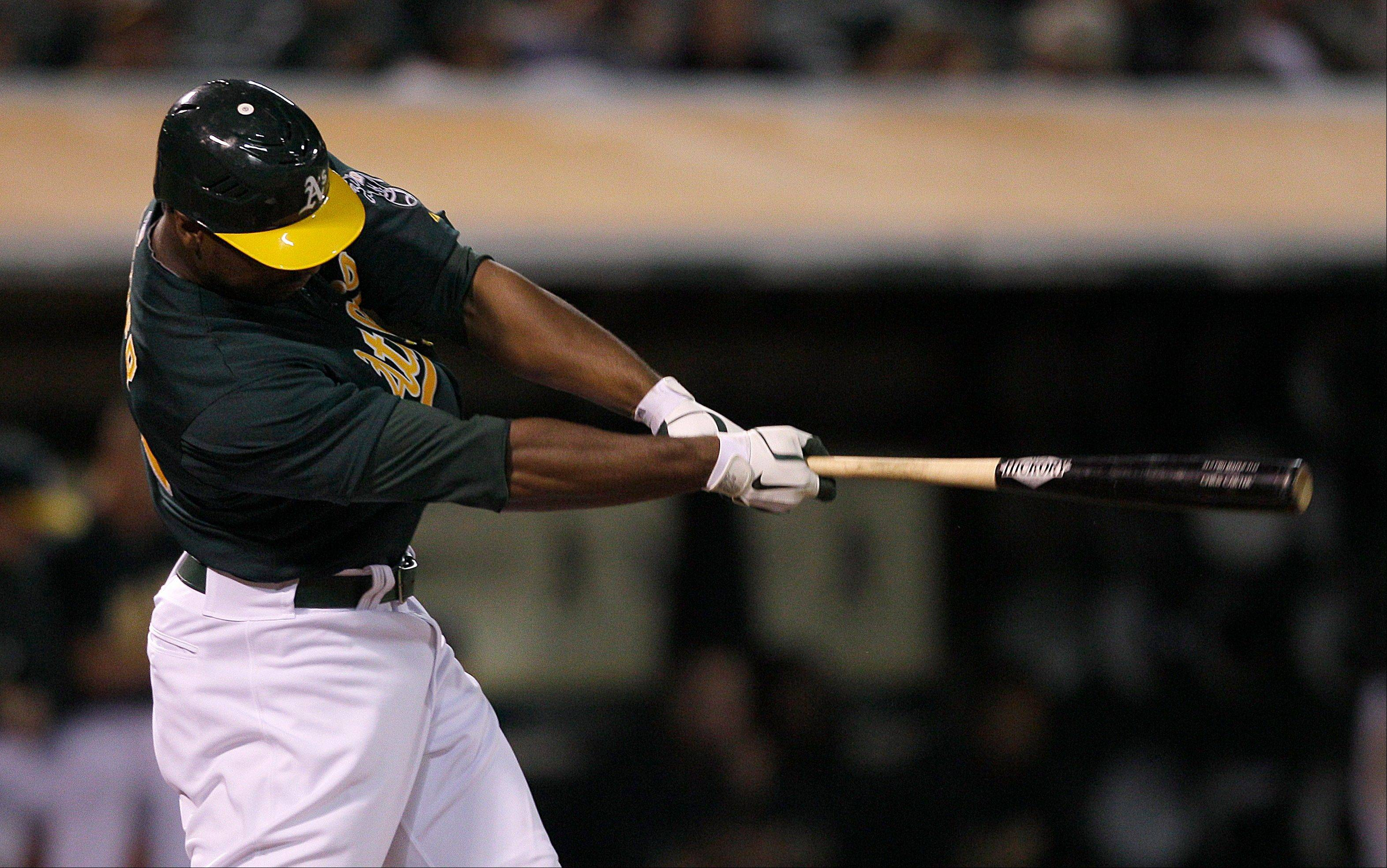 Oakland's Chris Carter hits a three-run home run during the 11th inning Friday at home against Seattle.