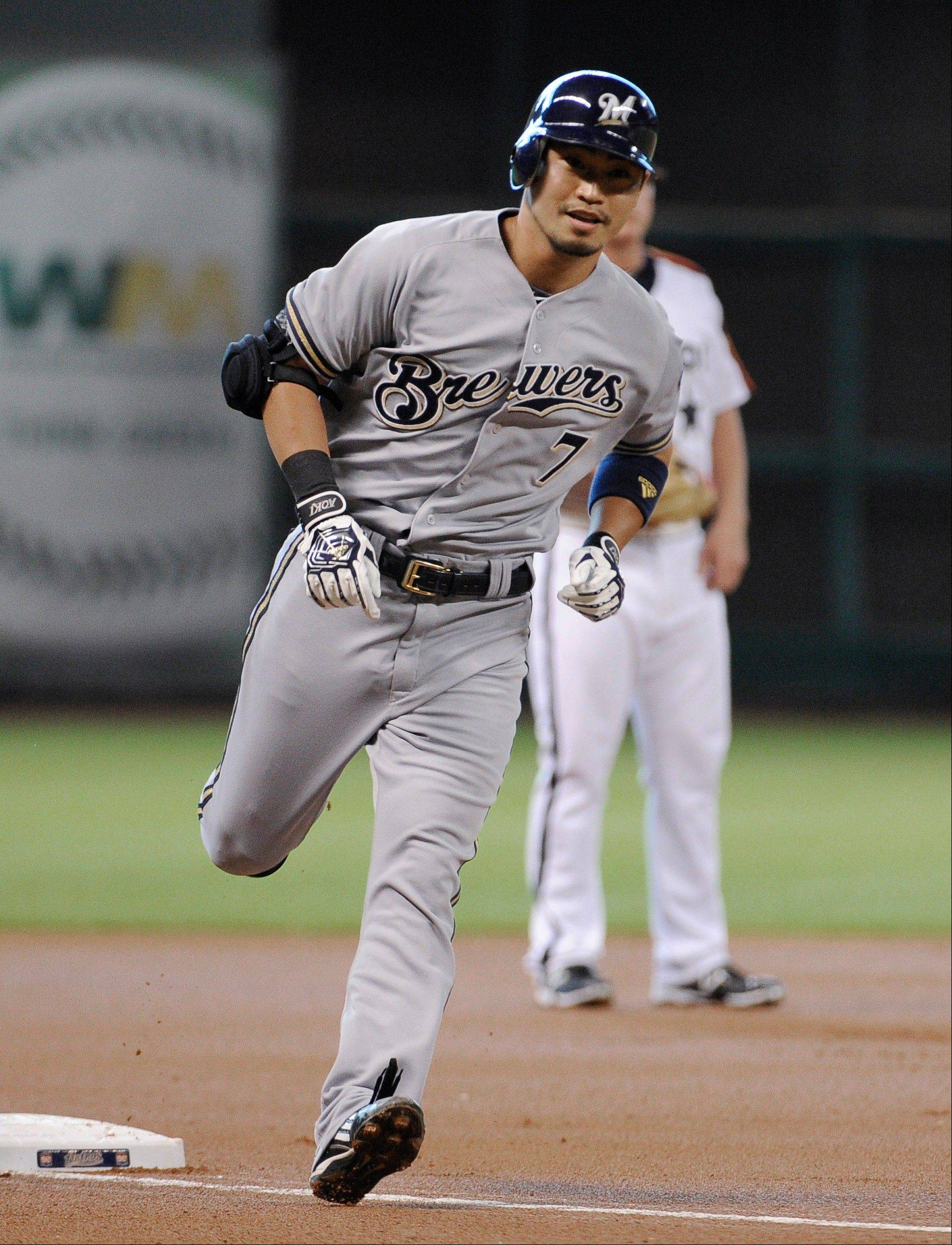 Milwaukee's Norichika Aoki rounds third base on a solo home run against the Astros in the first inning Friday in Houston.
