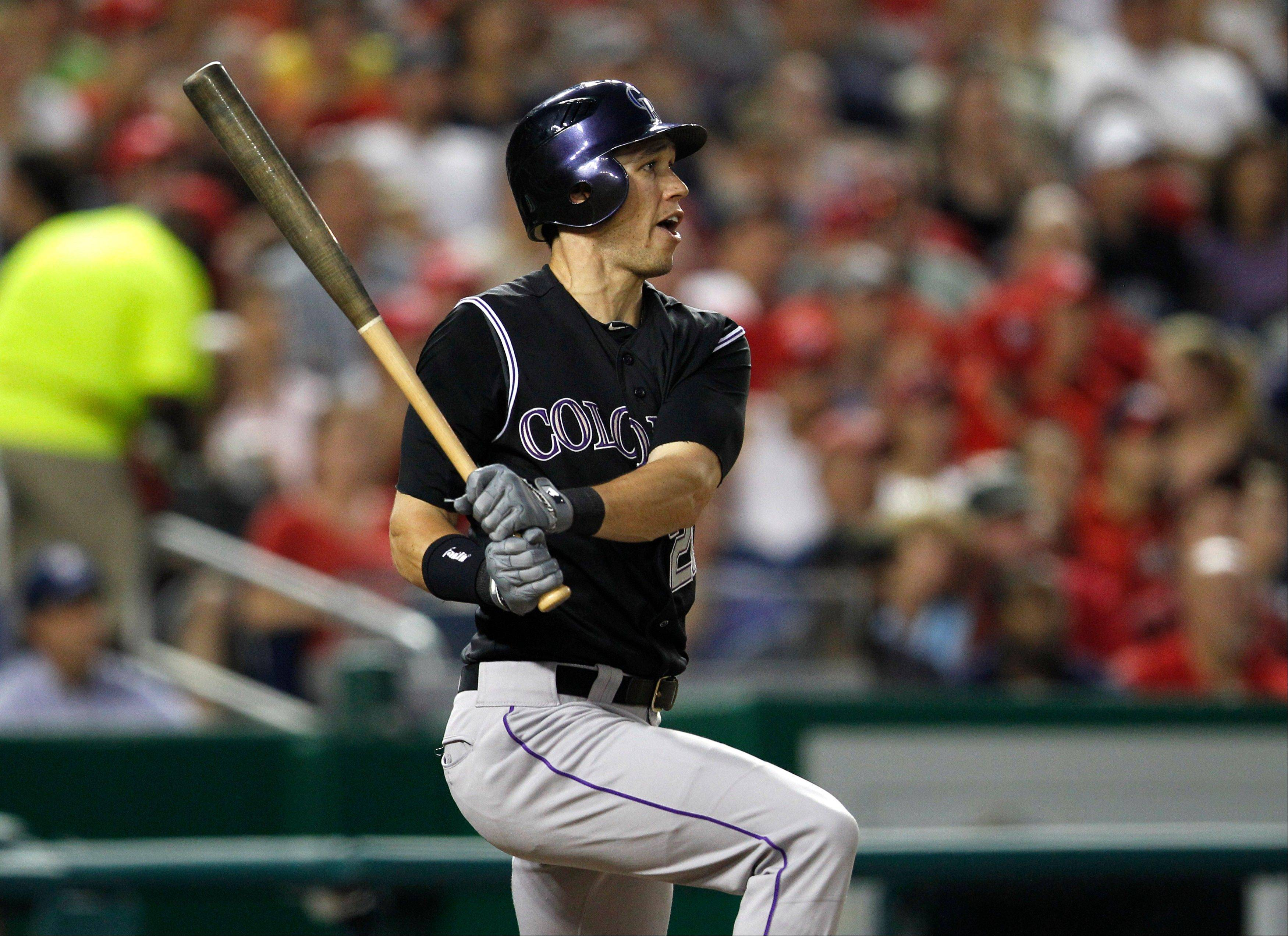 Colorado's Tyler Colvin hits a single against the Washington Nationals during the sixth inning Friday in Washington.