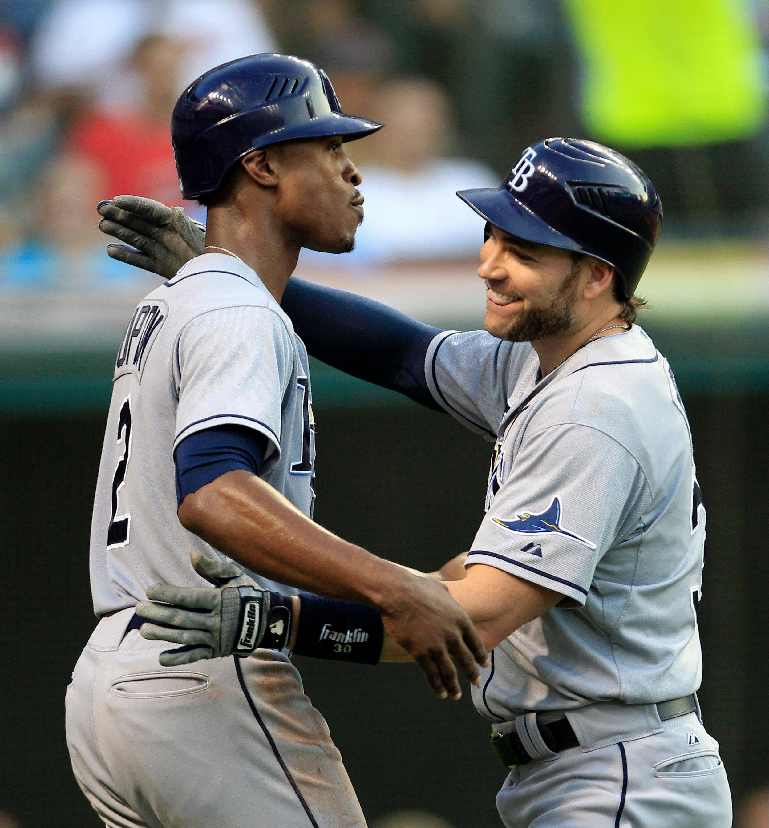 Tampa Bay's Luke Scott is congratulated by B.J. Upton, left, after hitting a two-run home run off the Indians' Justin Masterson in the fifth inning Friday in Cleveland.