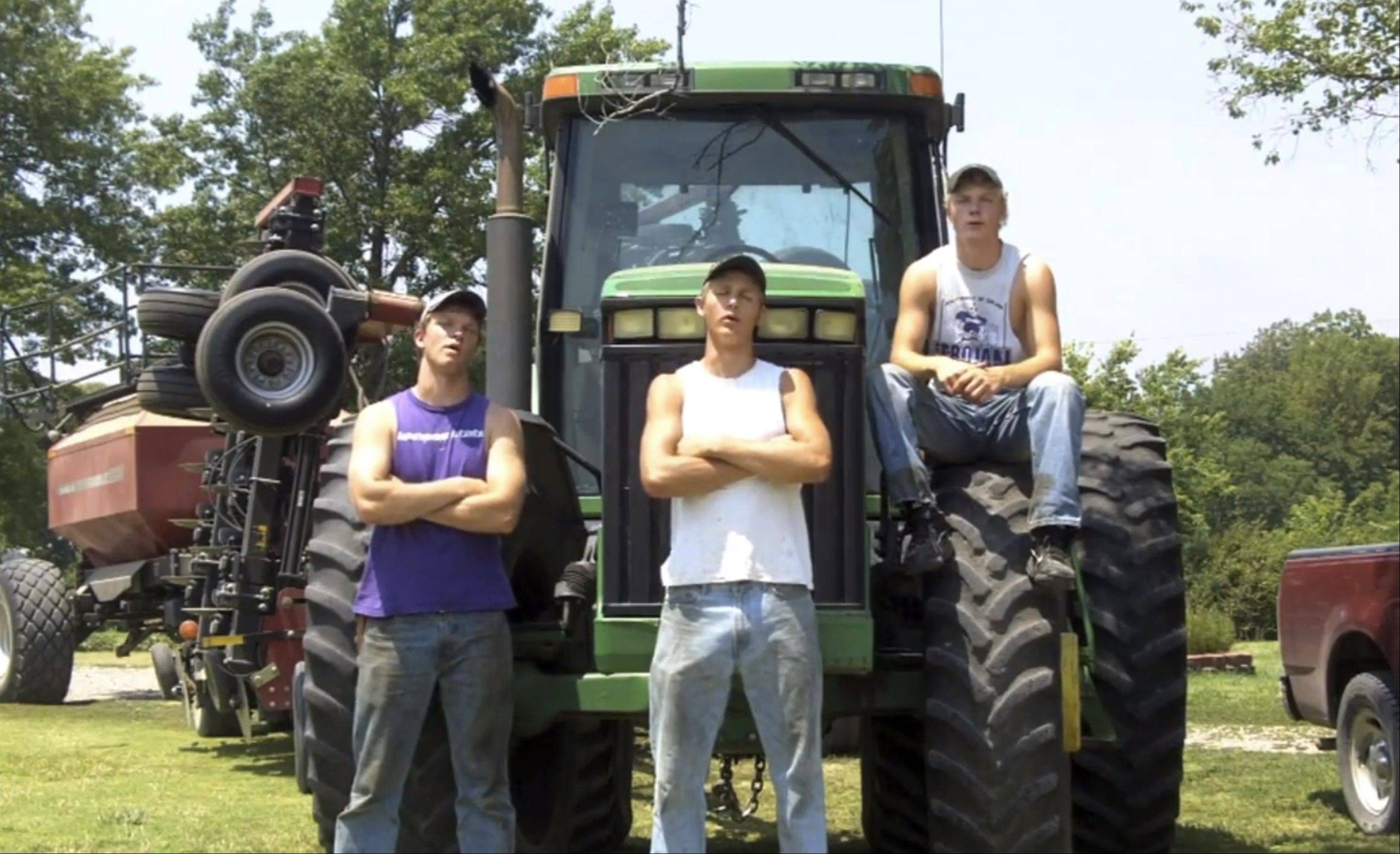 "This frame grab from video shows Assaria, Kan., brothers, from left: Nathan; Greg and Kendal Peterson in their video parody on LMAFO's ""Sexy and I Know It."""