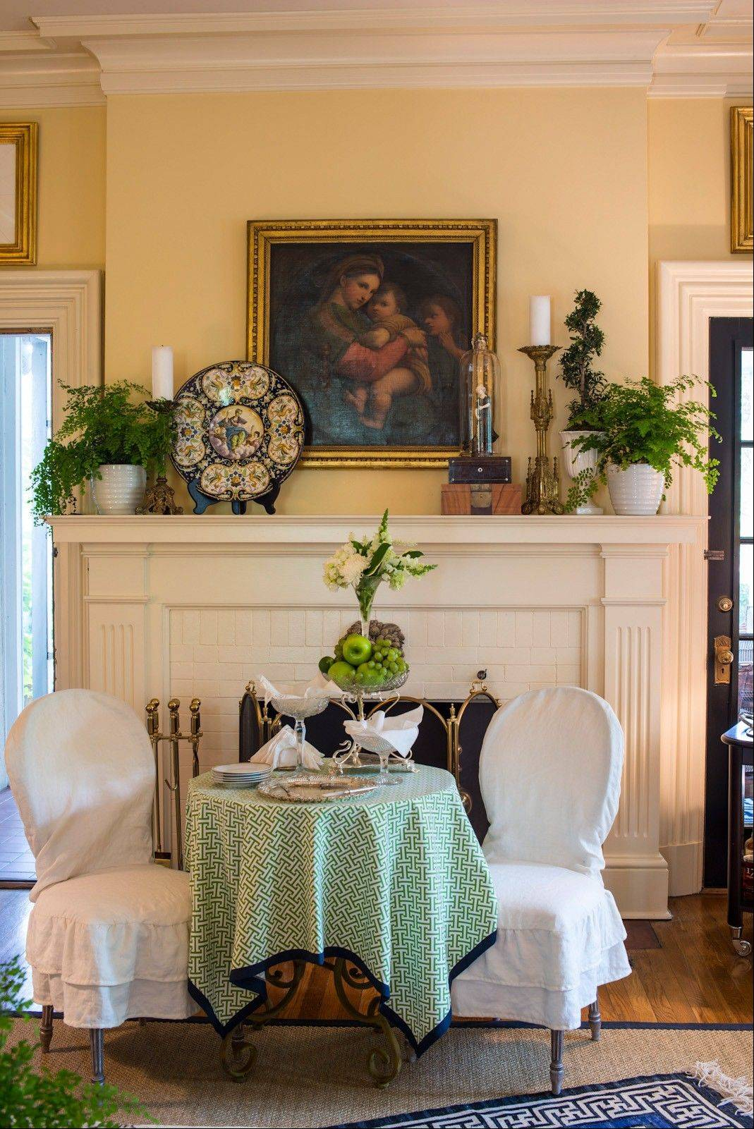 Hanging a bold piece of contemporary art over the fireplace mantel is one way to give this all-important spot a new look.