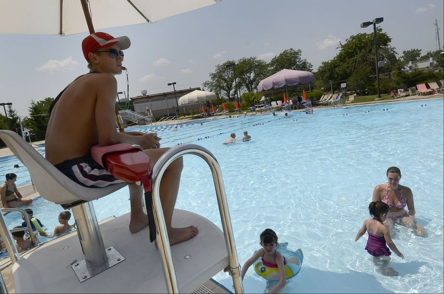 Lifeguard Andre Burck of Mount Prospect mans his post with the temperature already at 100 degrees Friday at the Meadows Park Aquatic Center in Mount Prospect. The excessive heat even kept people from going to the pool.