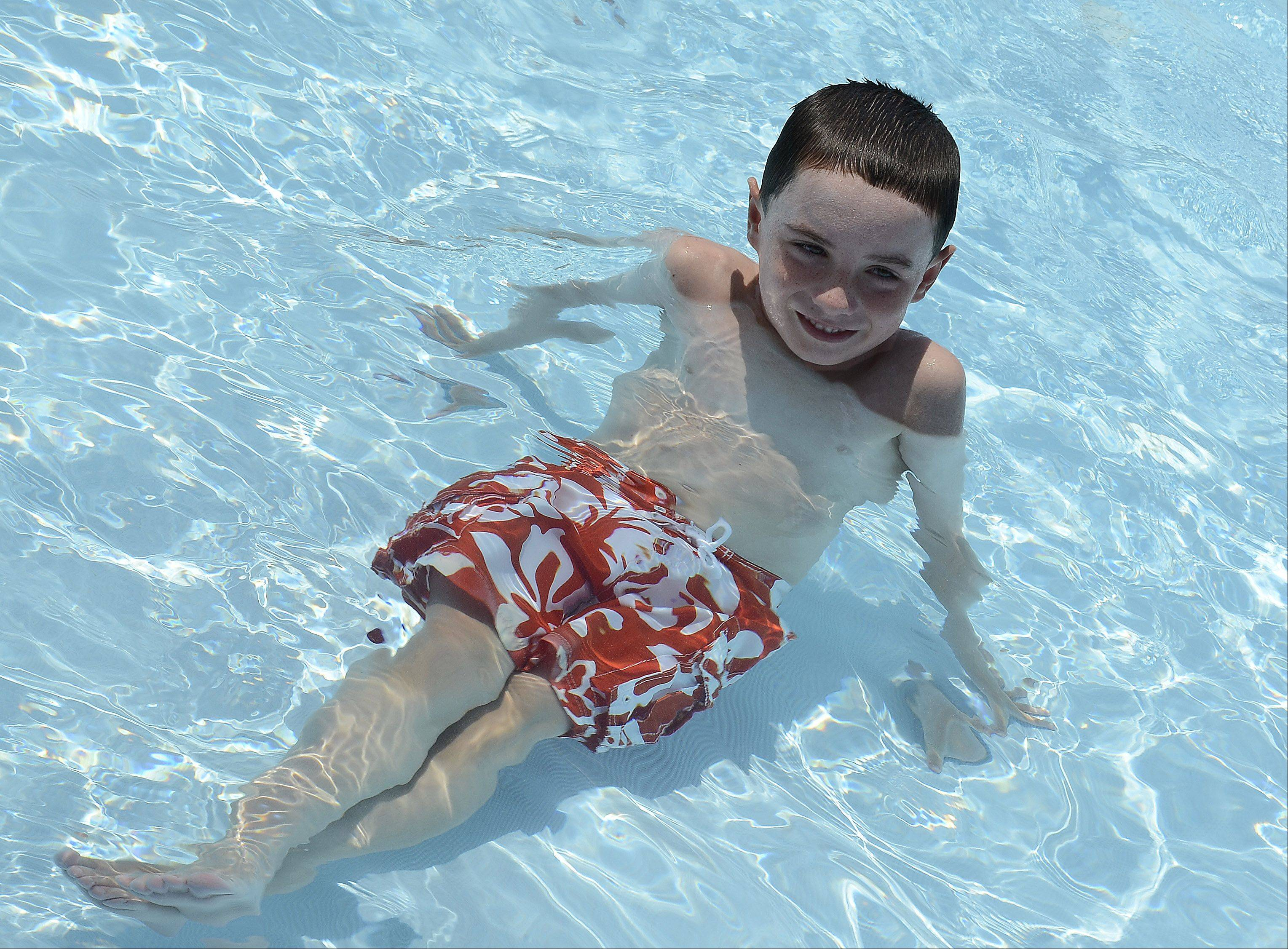 Sean Manning, 8, of Arlington Heights kicks back and cools off at the Meadows Park Aquatic Center in Mount Prospect.