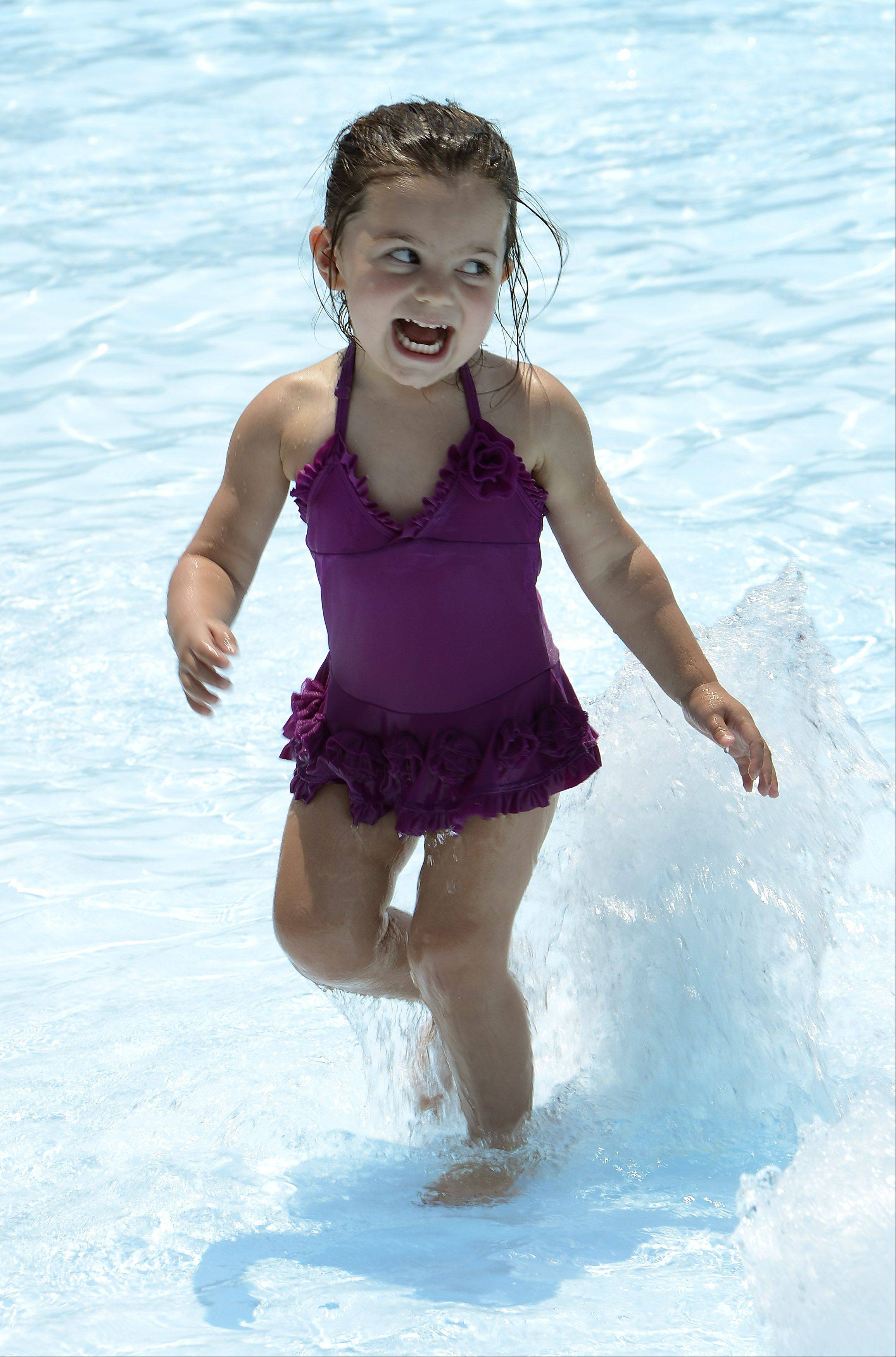 Two-year-old Lia LaValle of Arlington Heights cools off the Meadows Park Aquatic Center in Mount Prospect.