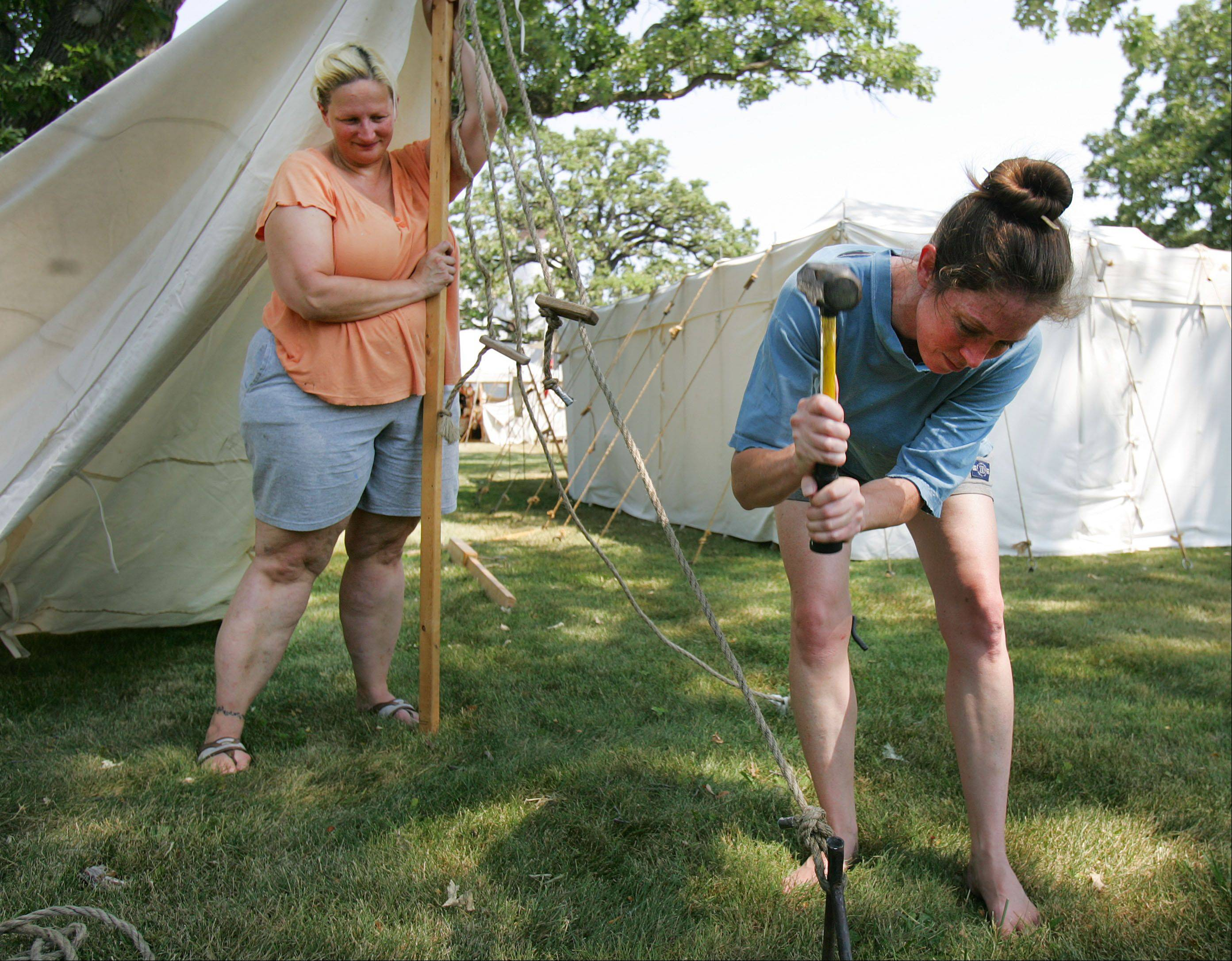 Soap makers Lori Malina of Lake Villa, left, and Laura Zielinski of Kenosha, Wisconsin set up their tent in preparation for Civil War days at Lakewood Forest Preserve near Wauconda .